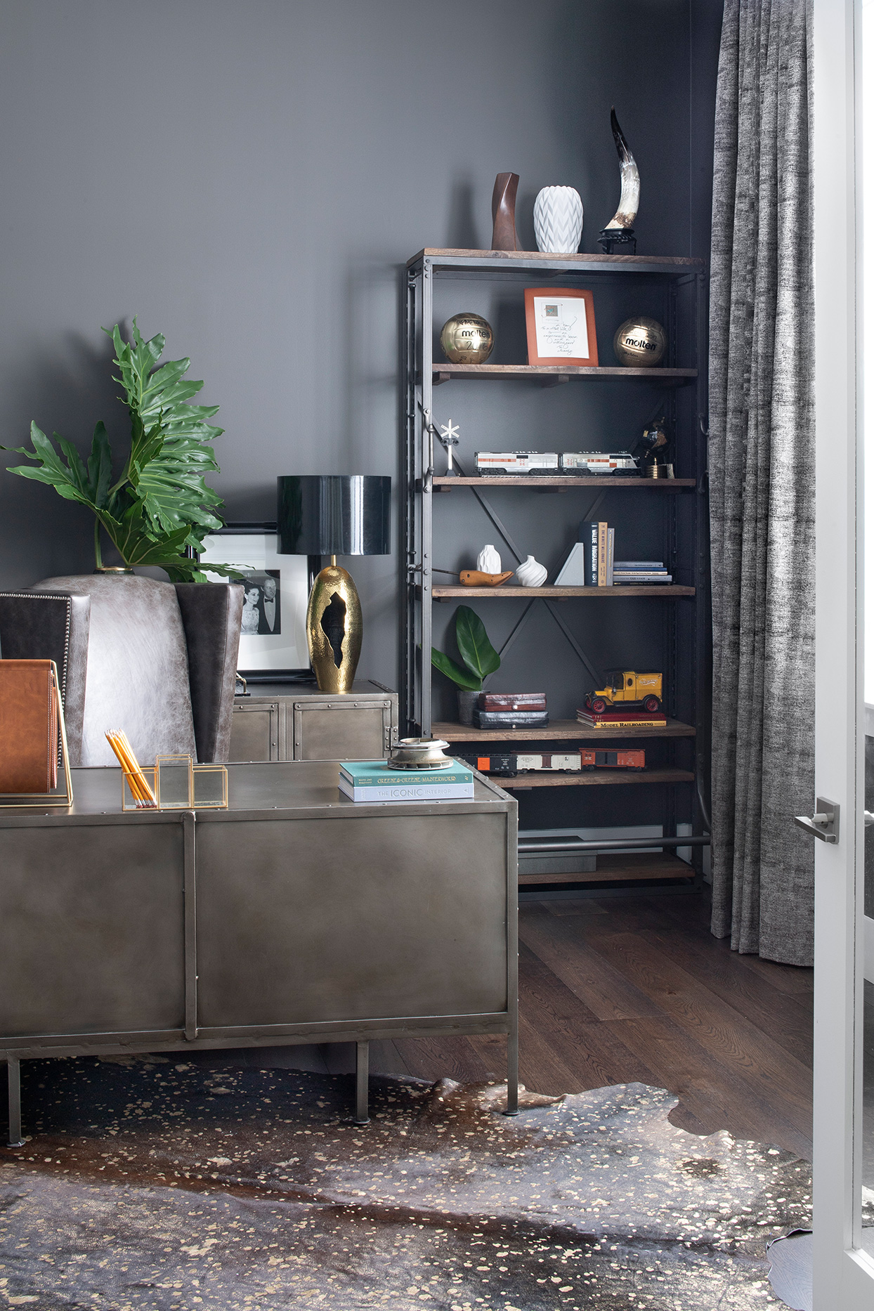industrial tones home office with animal skin rug