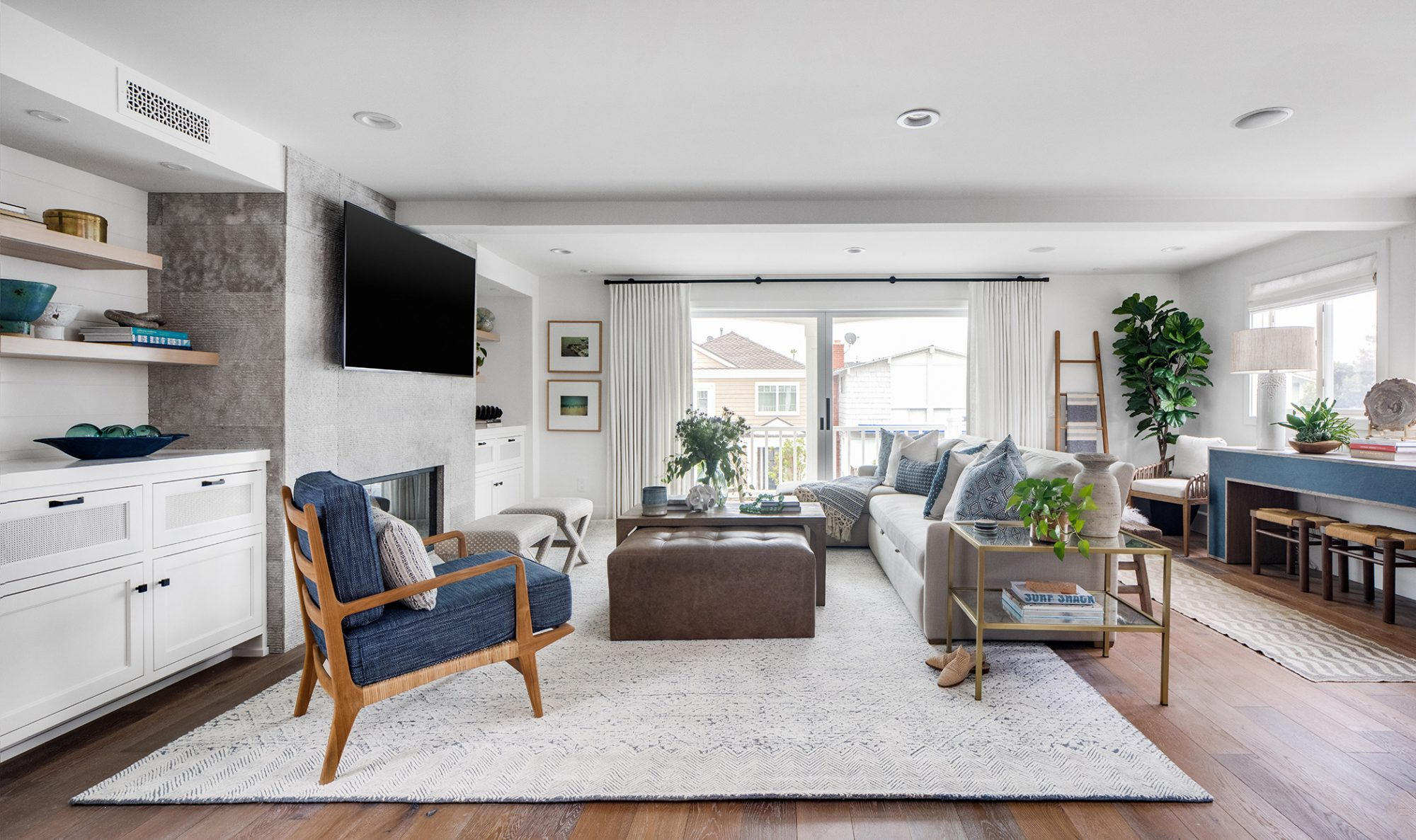 white and blue expansive living room with wood floors