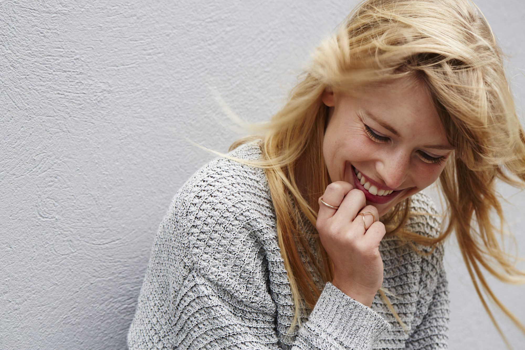 woman laughing hair blowing in wind