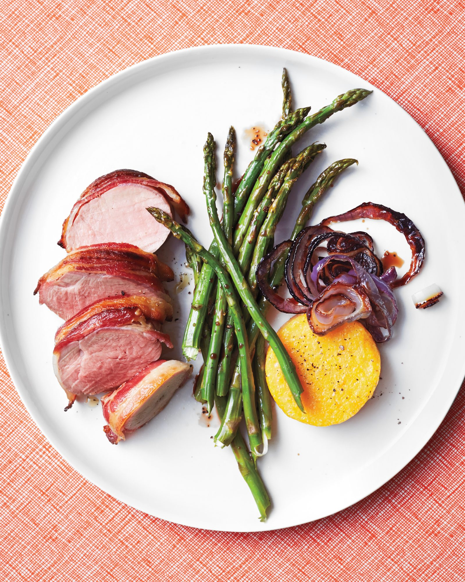 bacon wrapped pork with asparagus and polenta