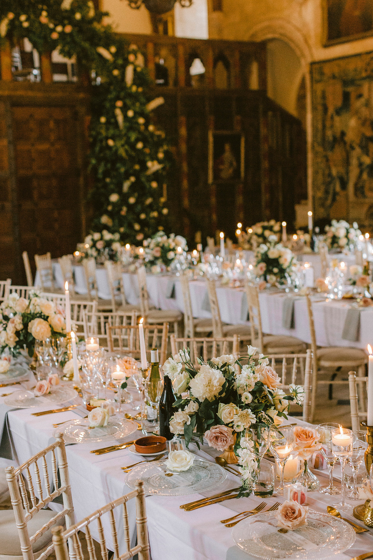 gold, pink and floral decorated wedding reception long tables