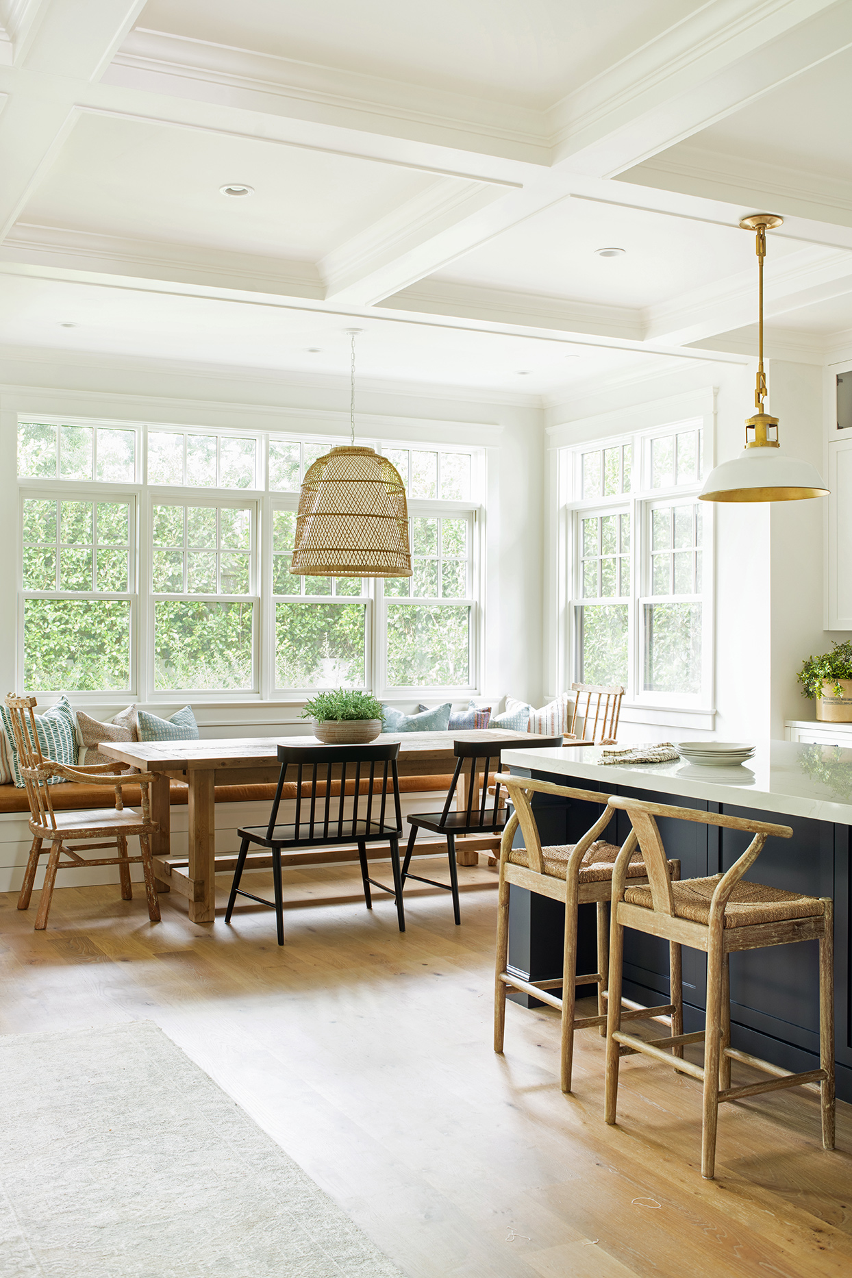 california chic naturally lit breakfast nook with wood table