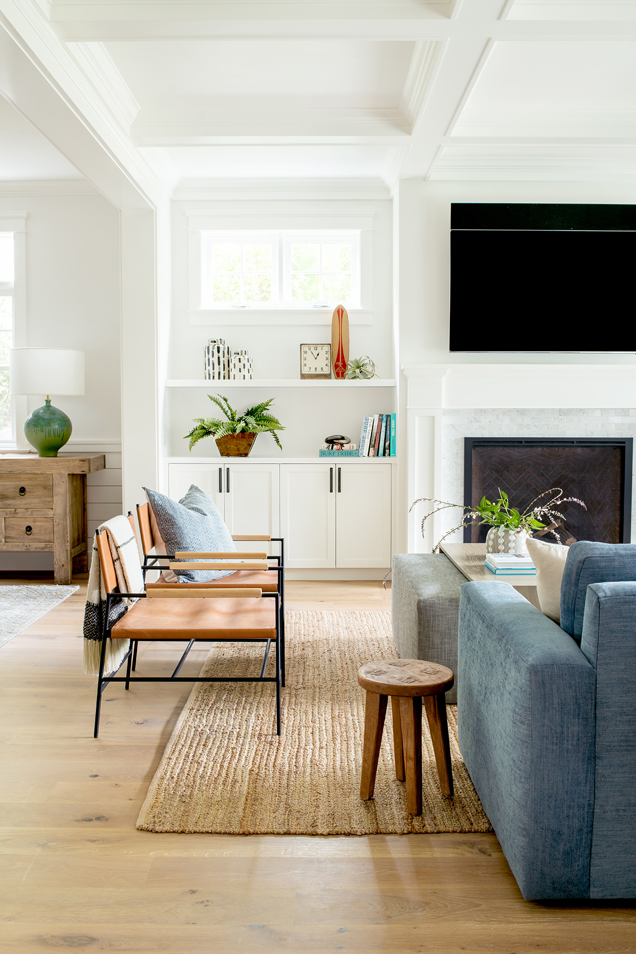 white, blue, and brown living room with black metal chairs