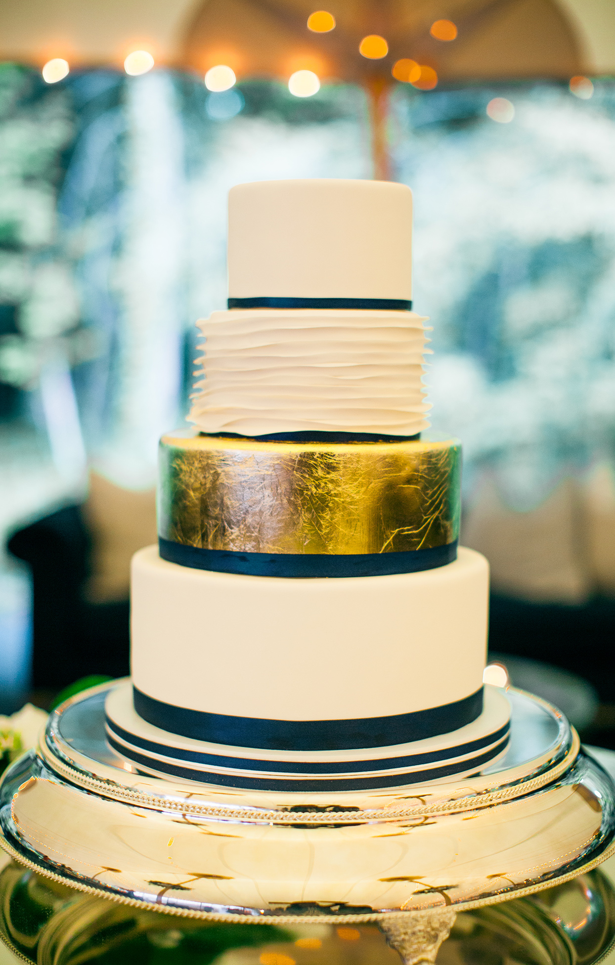 robert anthony wedding cake with golden accent layer