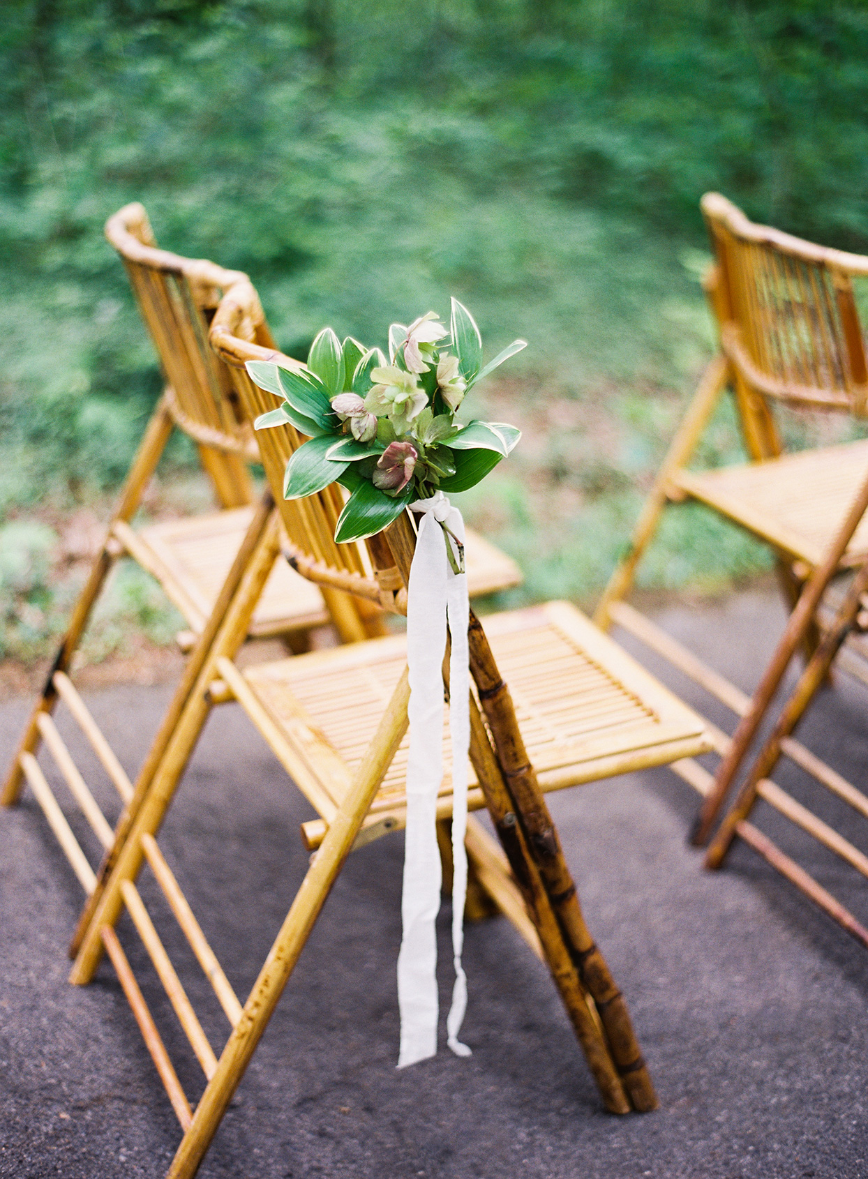 flowers tied to wooden ceremony chair