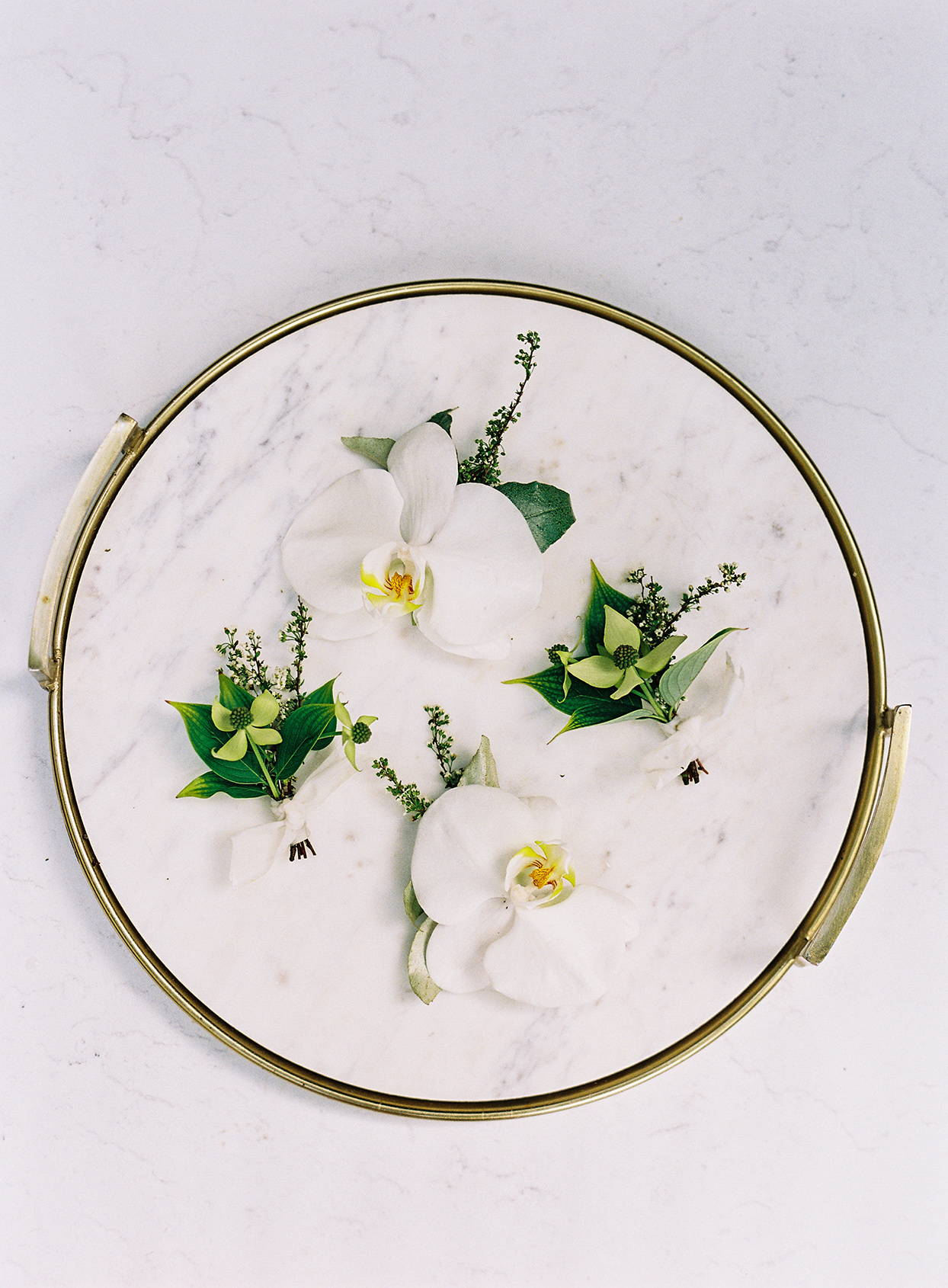 grooms' boutonnieres on marble tray