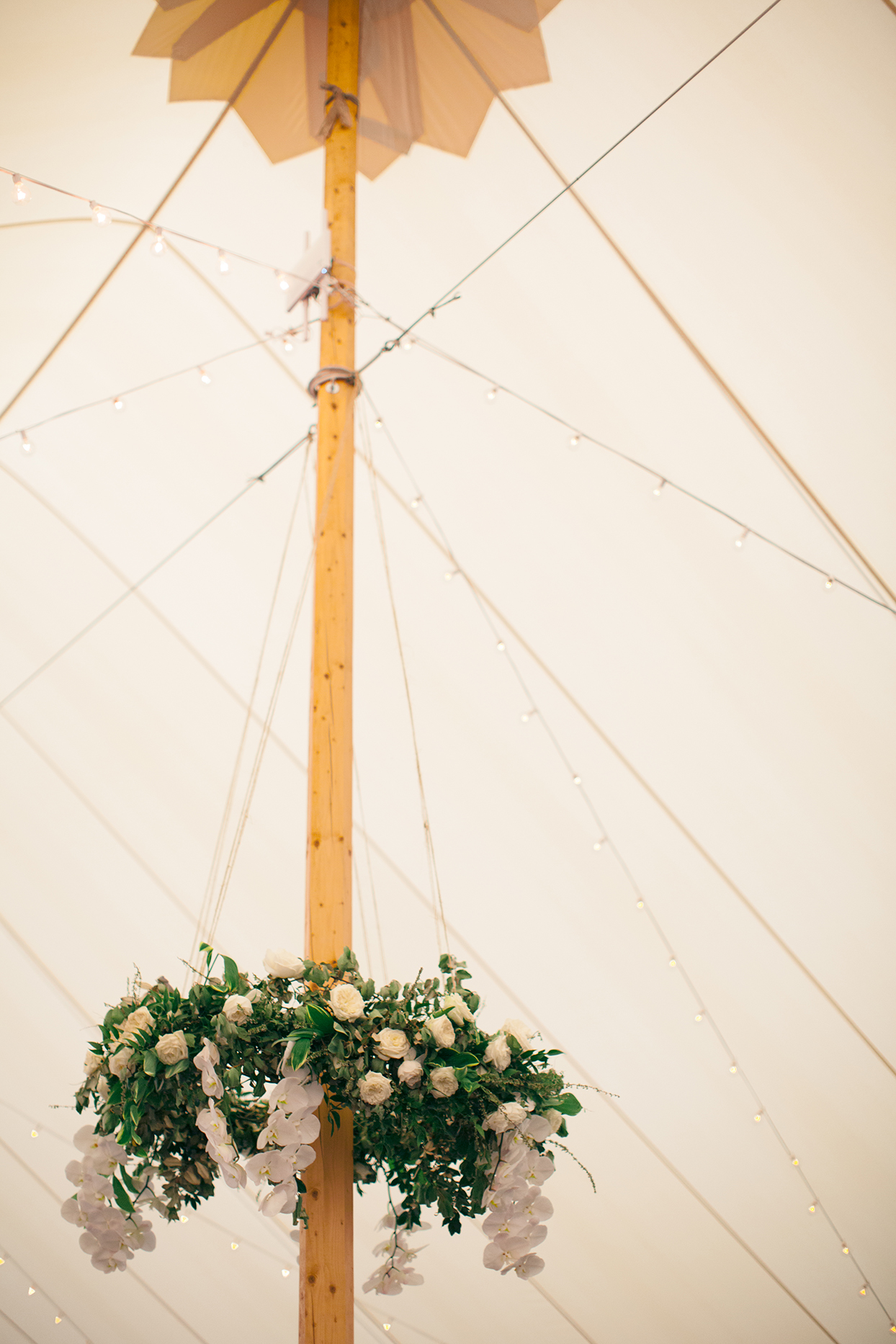 wedding tent pole with floral decorations