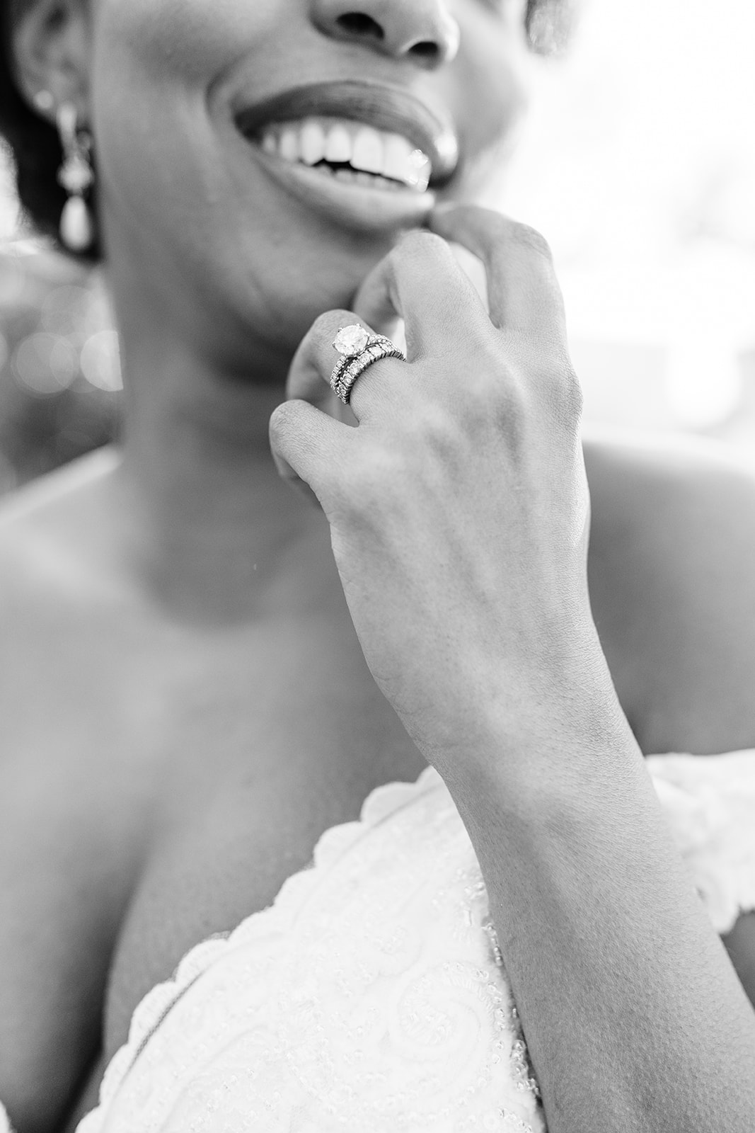 Bride with custom infinity band and diamond solitaire engagement ring