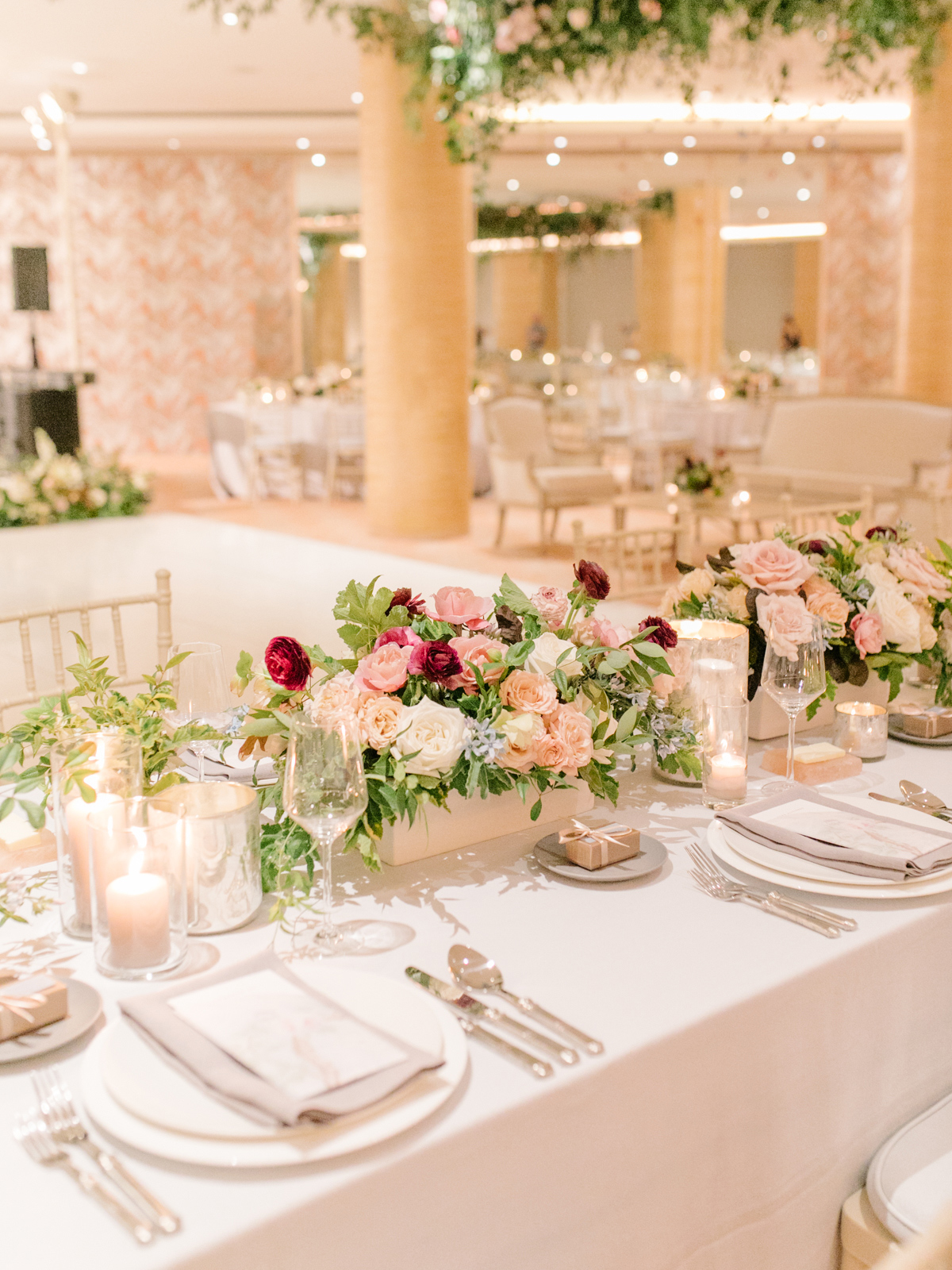 cream colored reception dinner tables with floral centerpieces