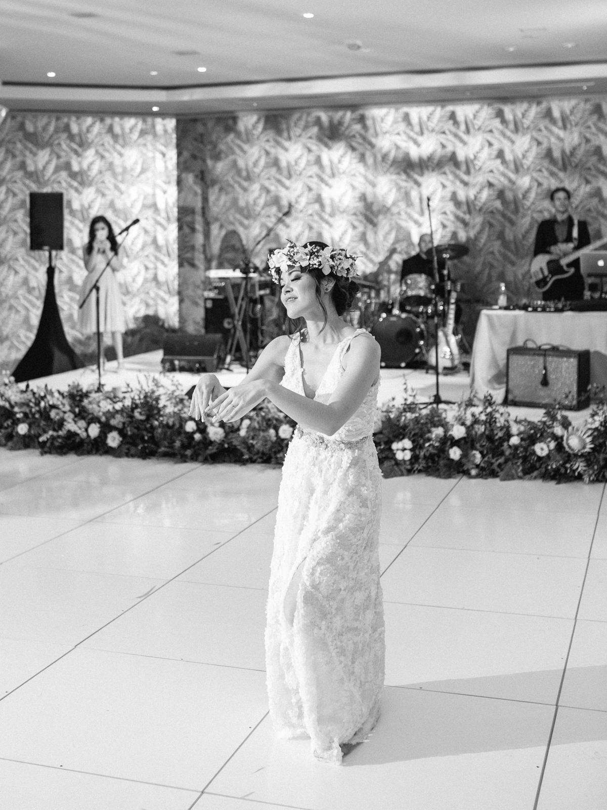 bride hula dancing at wedding reception in second dress
