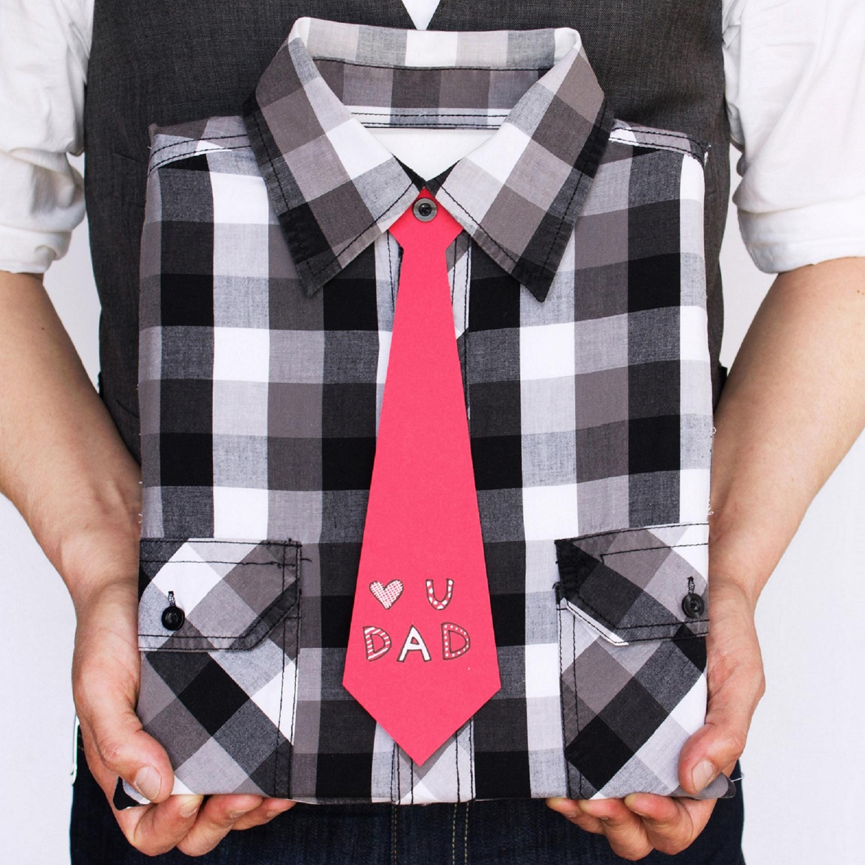 "If you want to make something for Father's Day and make use of old, unused items in your home, this craft will be a win-win. It uses one of Dad's old dress shirts for a one-of-a-kind gift-wrapped package. The finishing touch is the paper-made necktie scribbled to say, ""Love you, Dad.""To begin, cut off sleeves at the seam. Fasten the buttons, turn it inside out, and place your gift inside. Add the gift inside the shirt so you can pin where you need to sew. Remove the gift, sew the bottom and sides of the shirt, and trim any extra fabric. Slip in your gift, fasten the buttons, and fold the shirt's collar. Cut out a tie using cardstock paper, cut a slit and a circle at the top of the tie to fit around the top button of the gift-wrap, and secure it around the top button.Shop Now: Astrobrights Colored Card Stock, $5, target.com; Martha Stewart All-Purpose Scissors, $21, michaels.com."