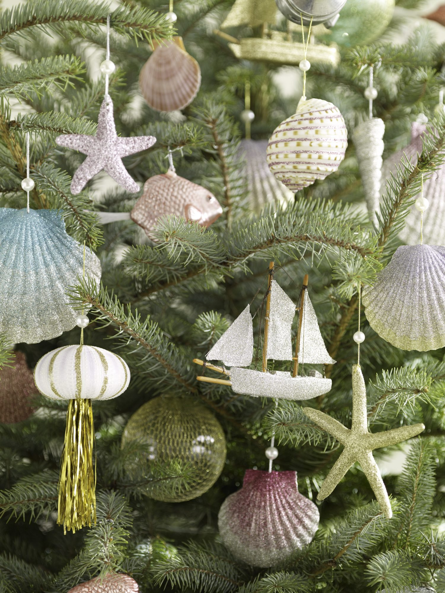 ombré glittered seashell ornaments on christmas tree
