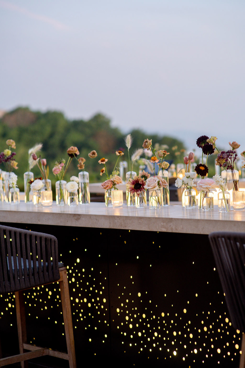 wedding bar decorated with vases of flowers and starry black design