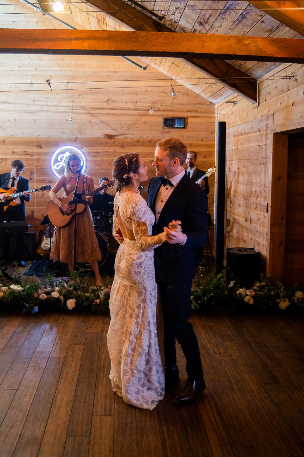 couple dancing for wedding reception in wooden event space