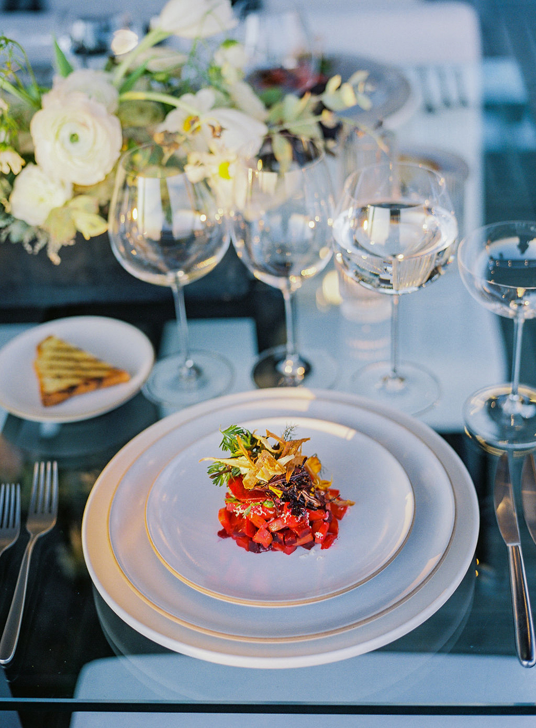 appetizer on white plates at wedding reception place setting