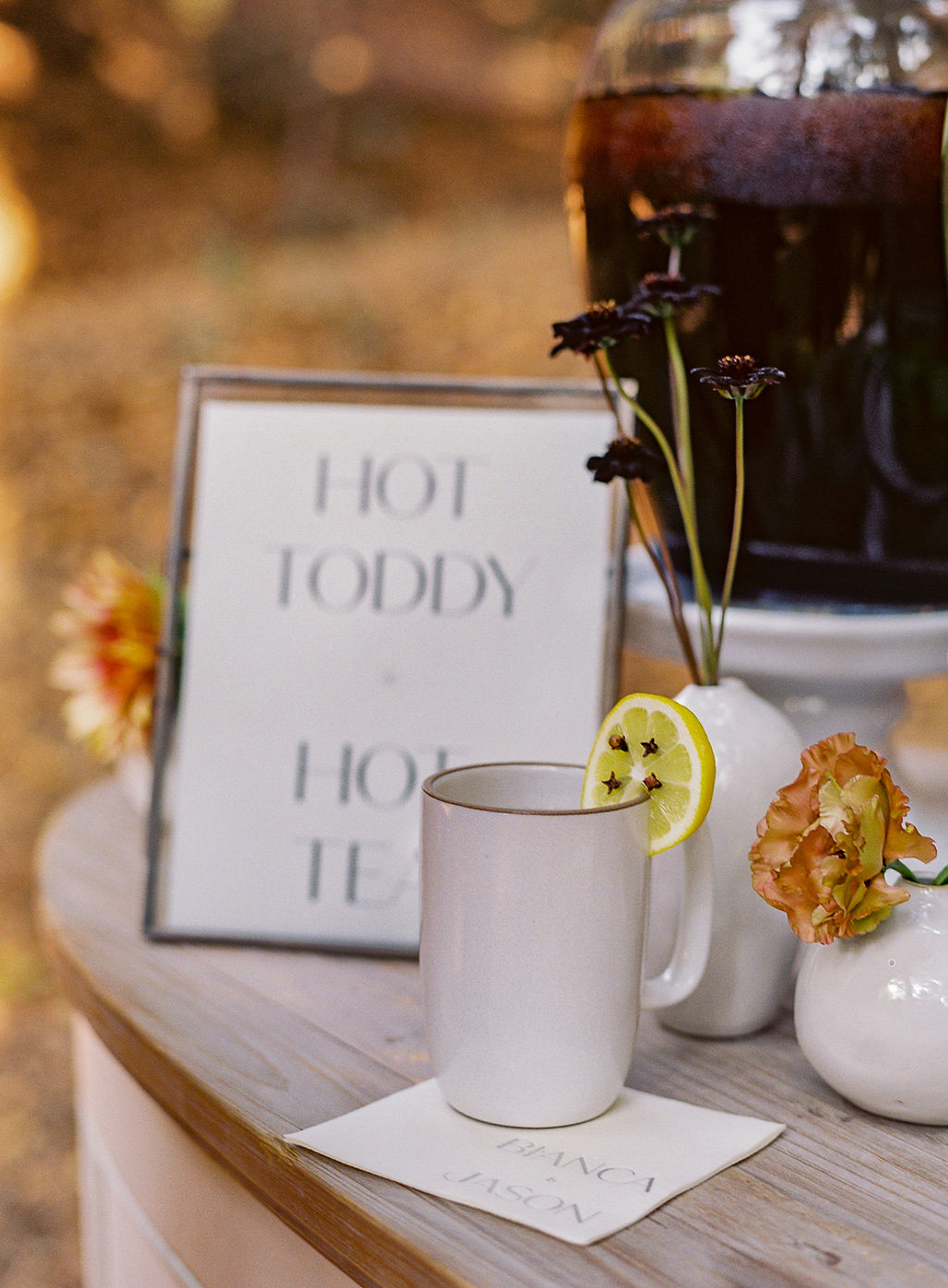 hot toddy in white mug on wooden table