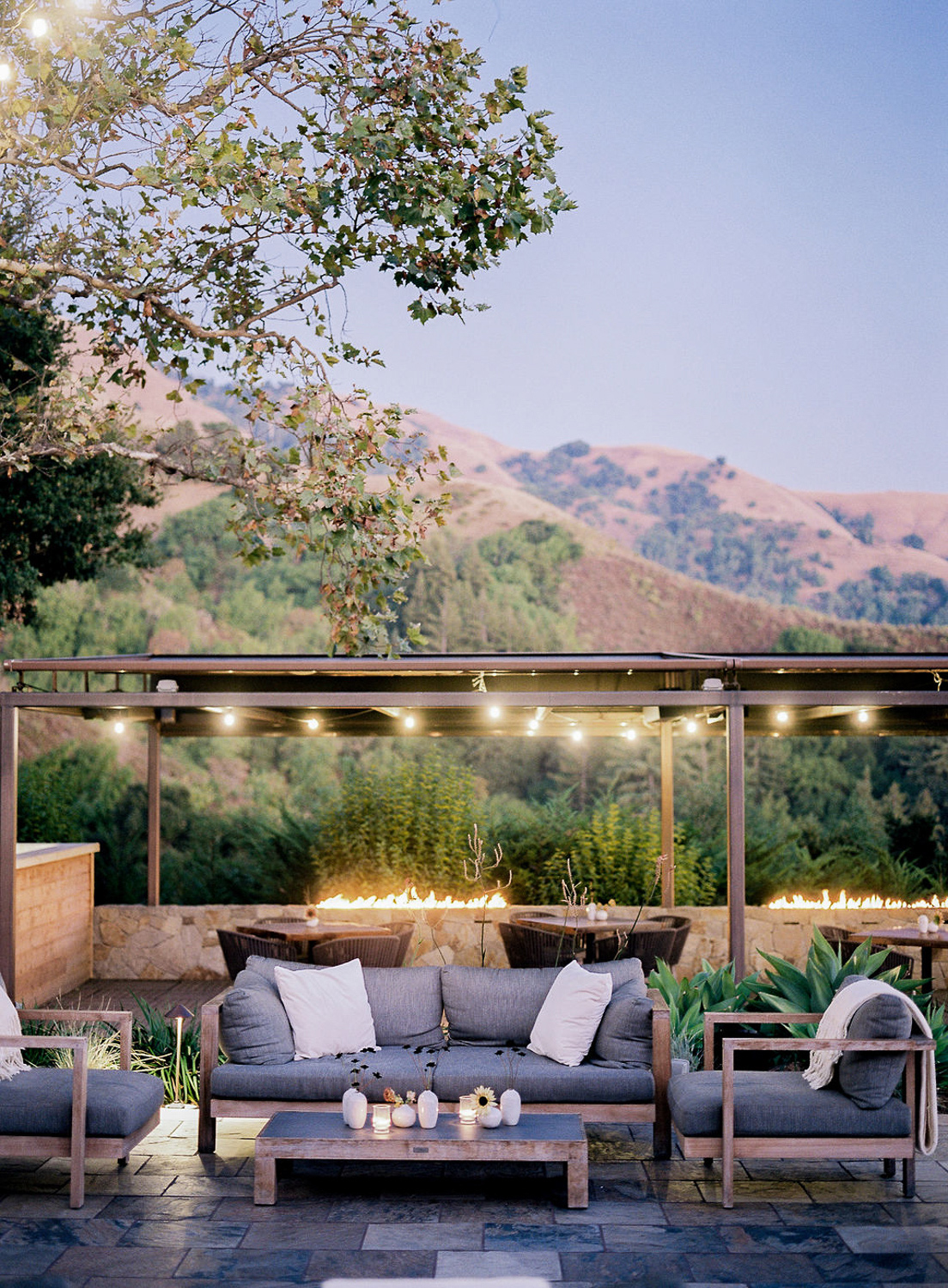 outdoor wedding lounge area with gray couches and fire