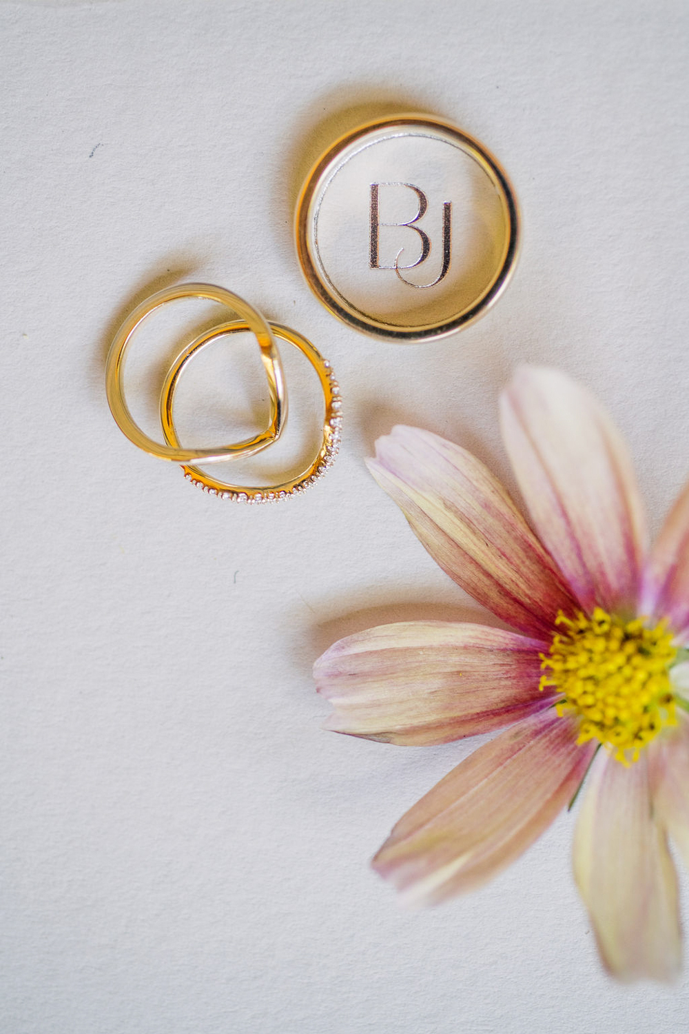 gold wedding rings with pink flowers