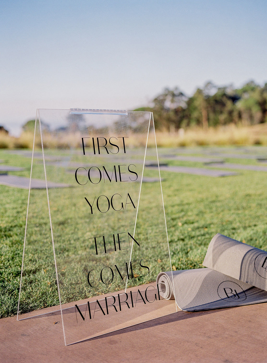 transparent wedding sign on lawn