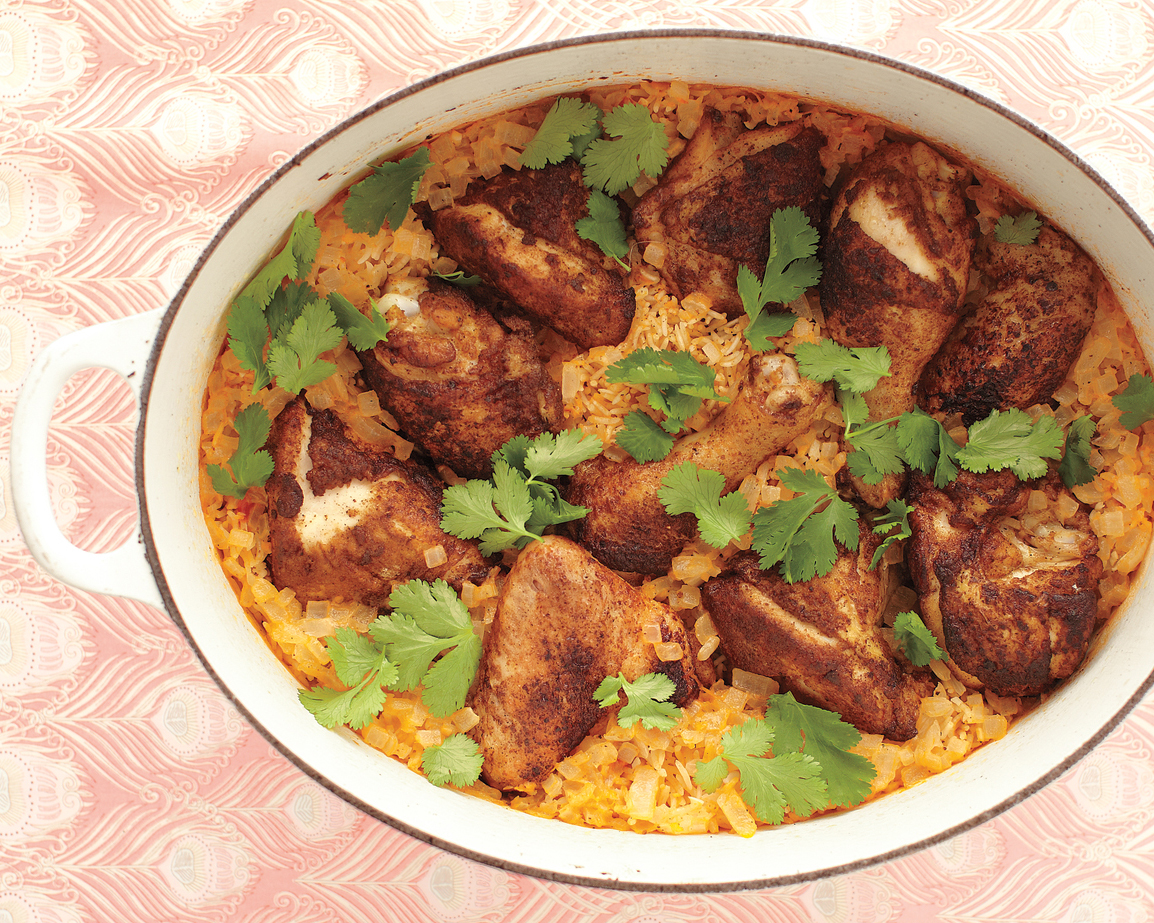 Winner, winner, chicken dinner! This one-pot recipe uses a whole chicken, which is more economical than buying individual pieces. The chicken pieces are rubbed with curry powder and cayenne pepper and cooked with rice and coconut milk in a Dutch oven.