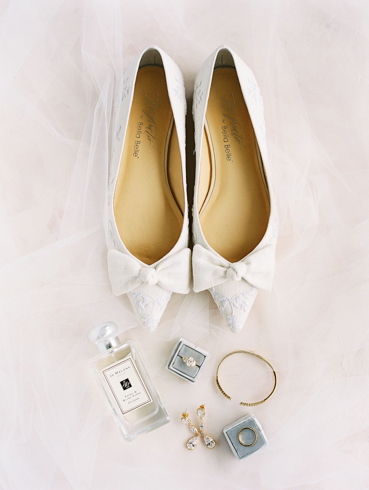 bride's white pointed heels and jewelry