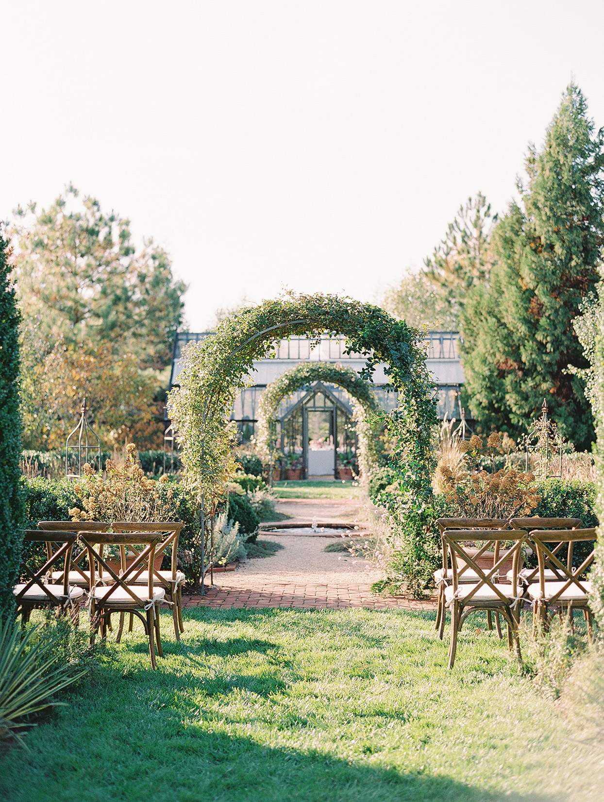 garden ceremony space with greenhouse in background