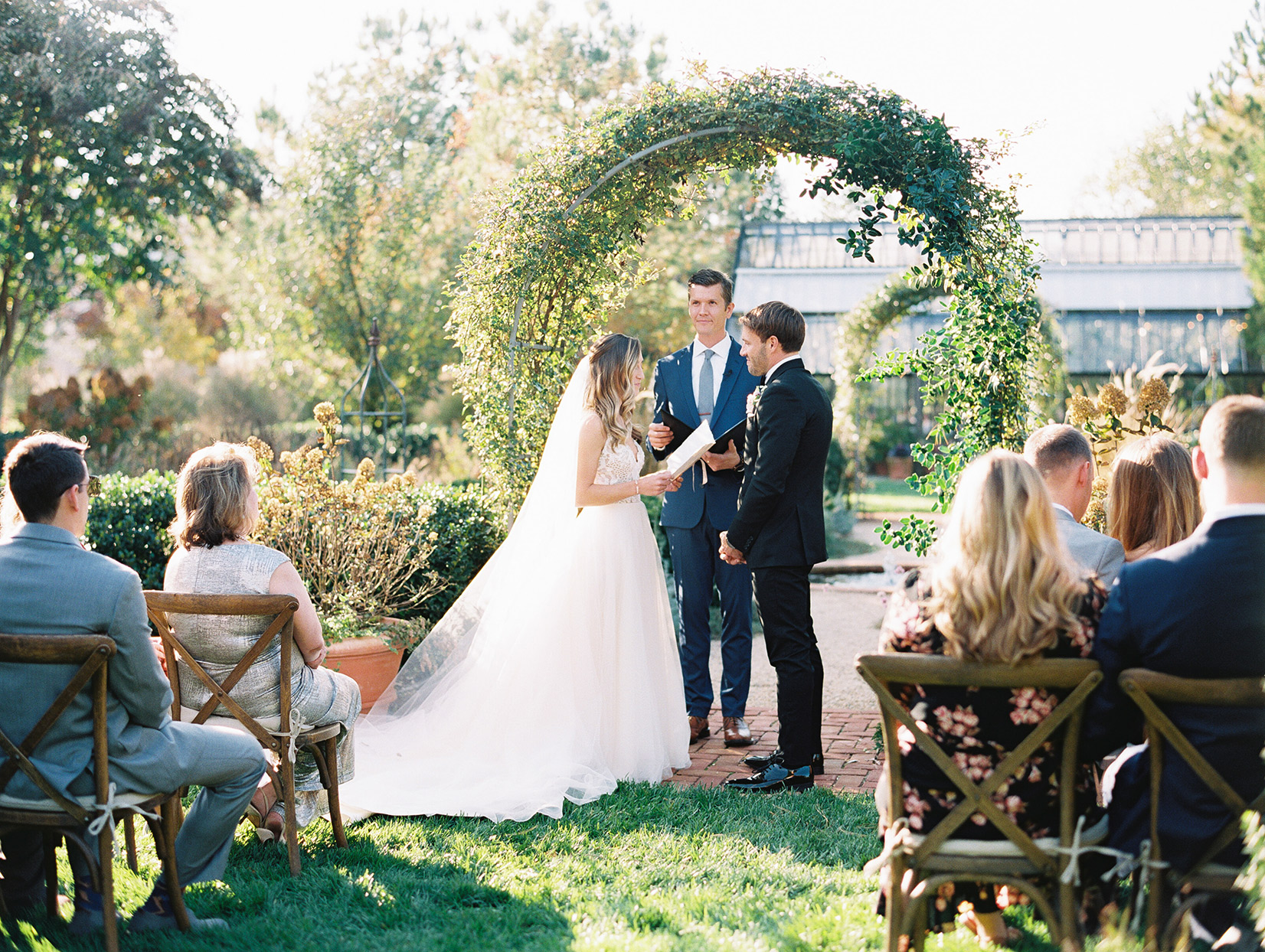 bride and groom exchanging vows in intimate garden ceremony