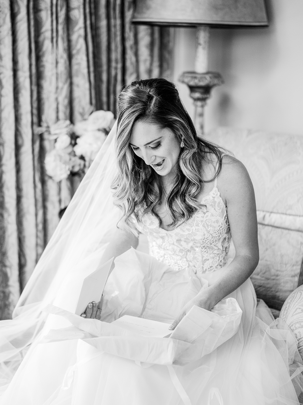 bride sitting on couch reading love letters