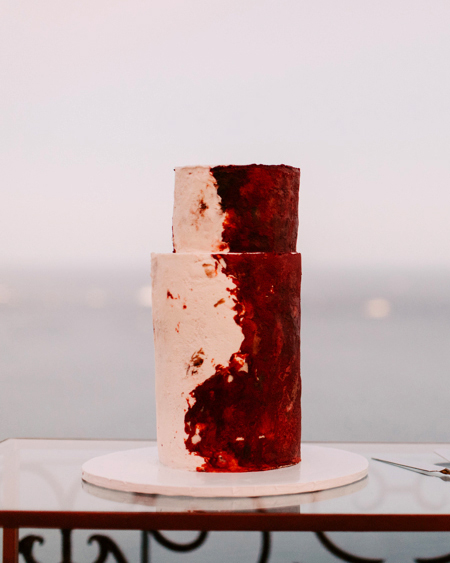 red and cream wedding cake on table