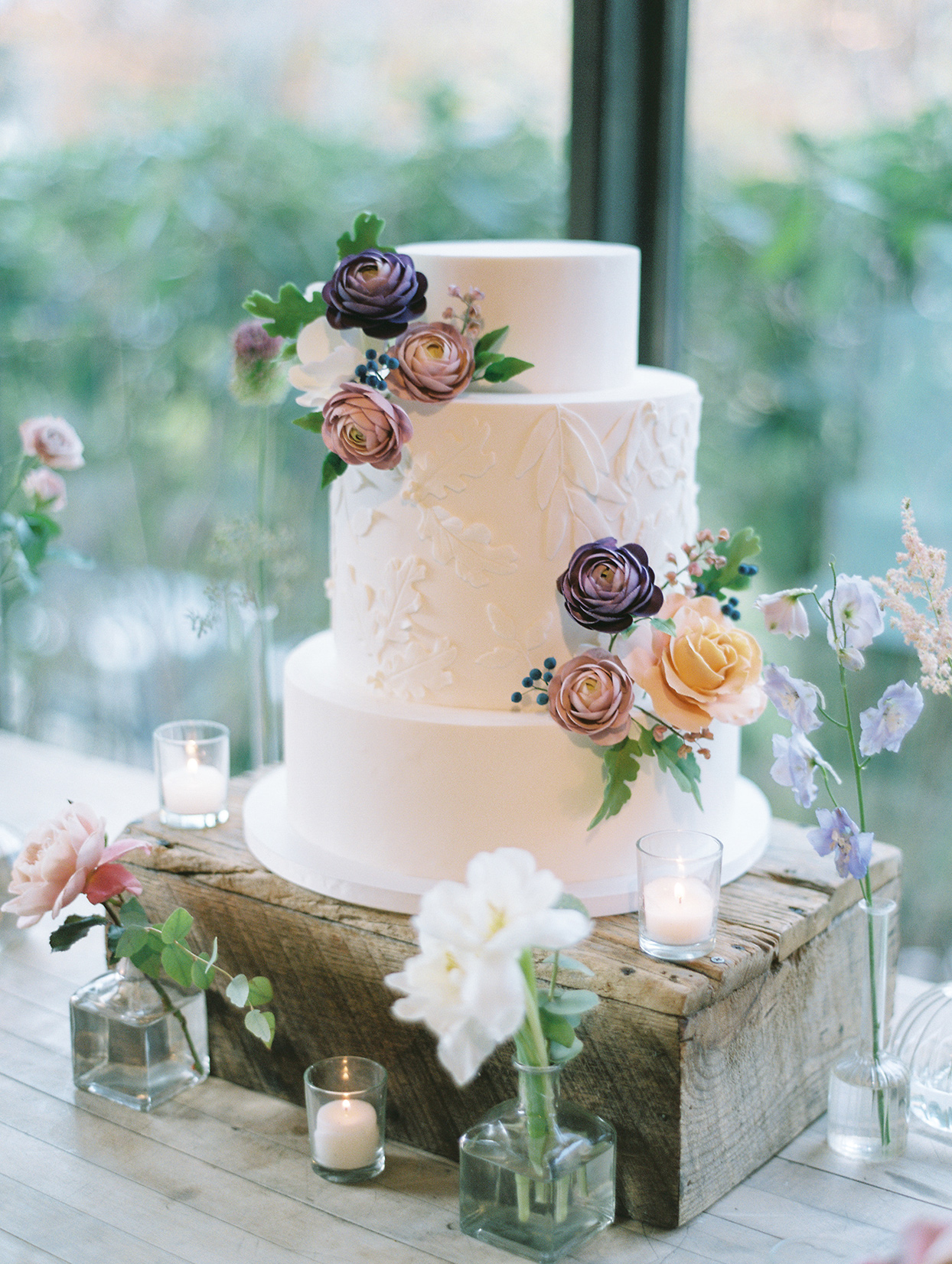 three tiered wedding reception cake with flowers