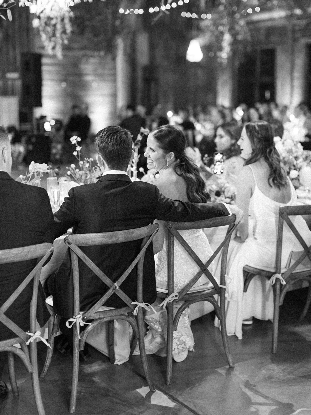 wedding reception couple sitting at long table