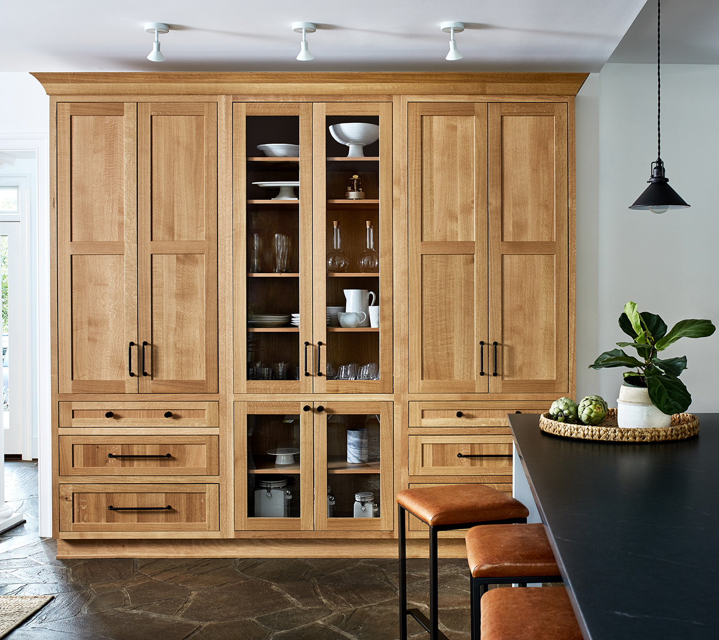 built in light wood cabinets in modern home