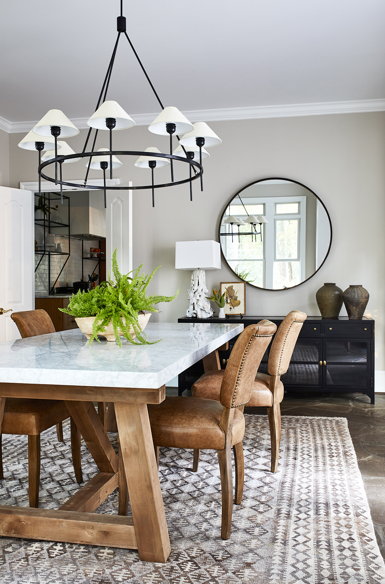 light colored dining room with black and brown accents