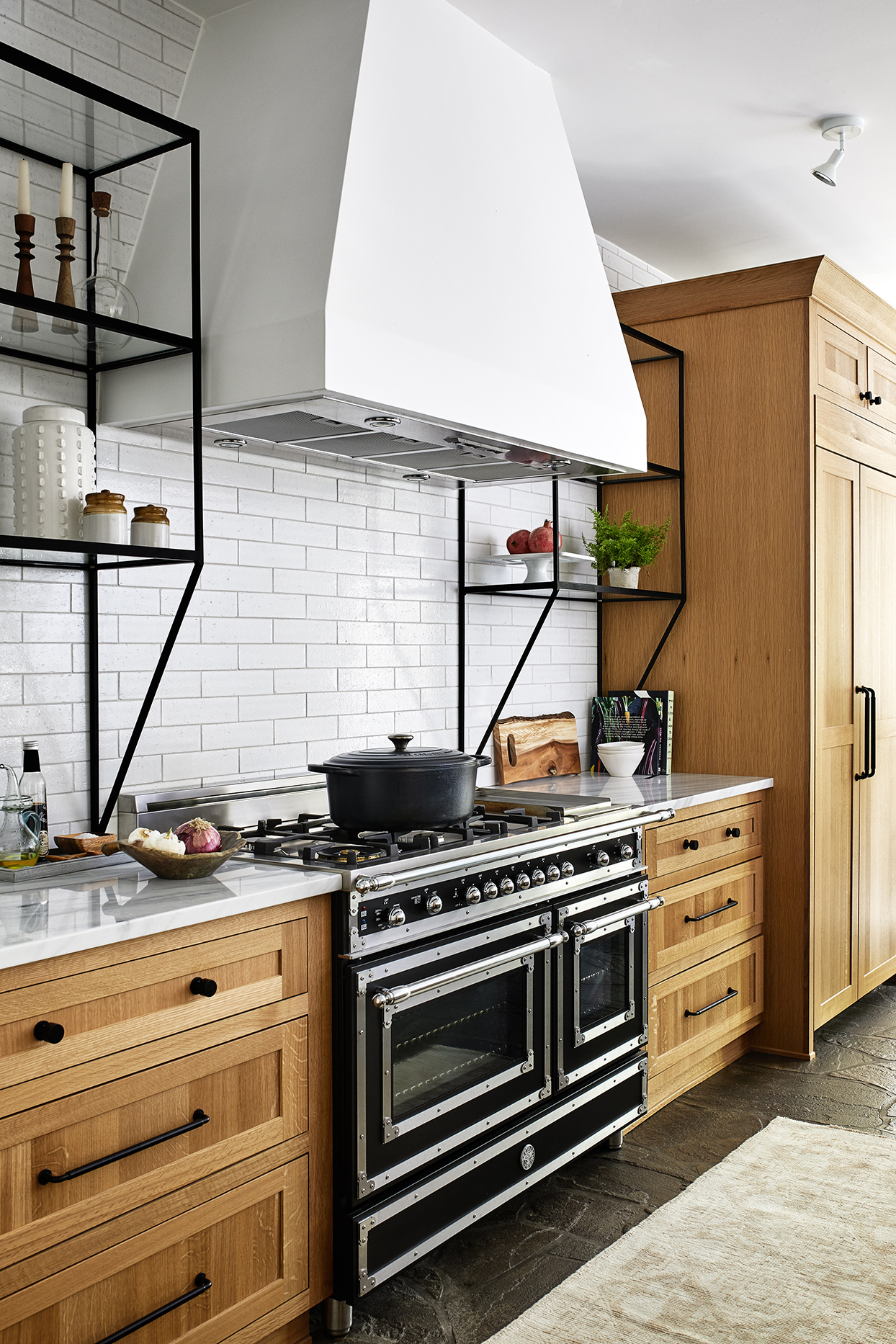 modern black and silver oven and stove in white kitchen