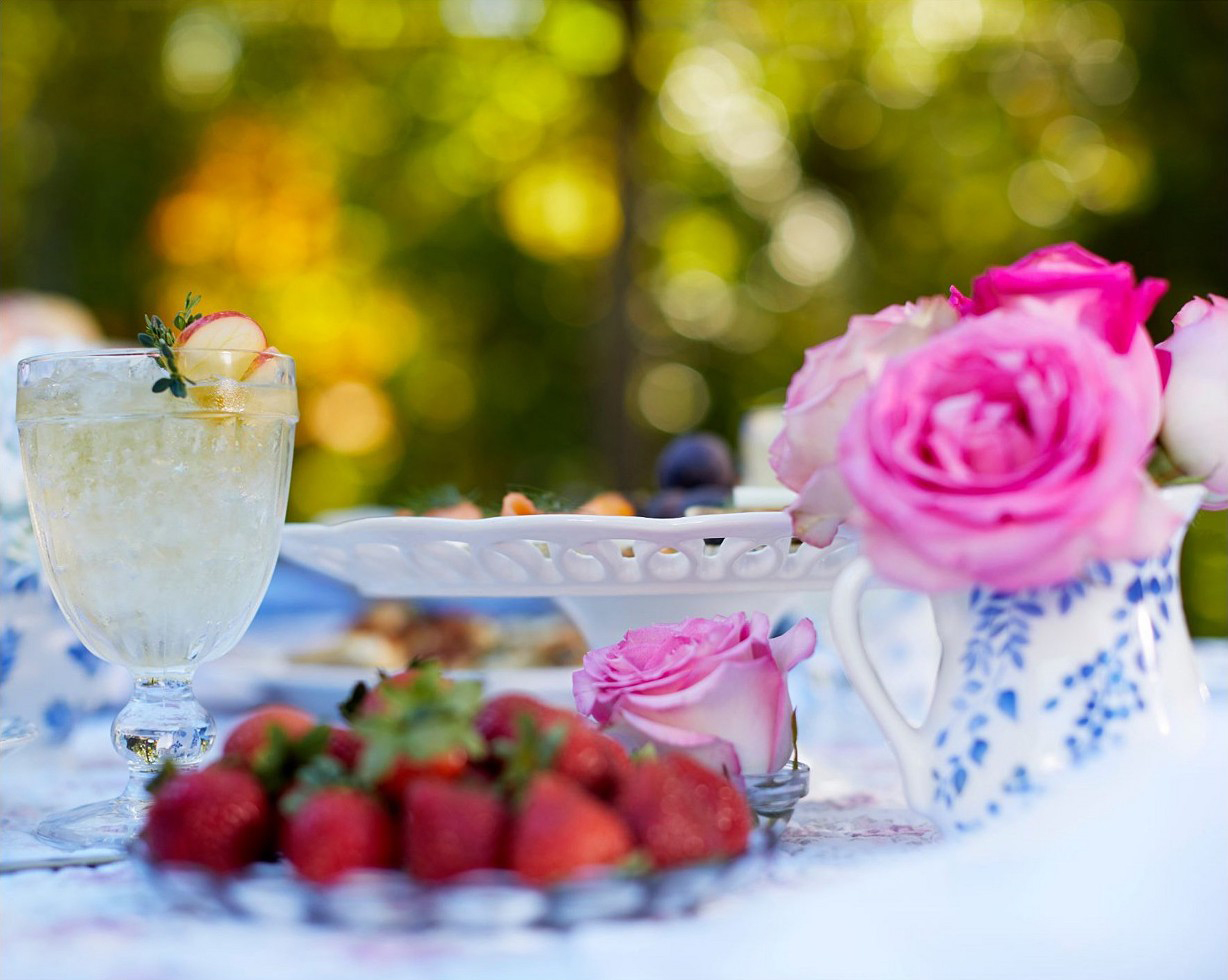 Outdoor table setting with flowers and strawberries