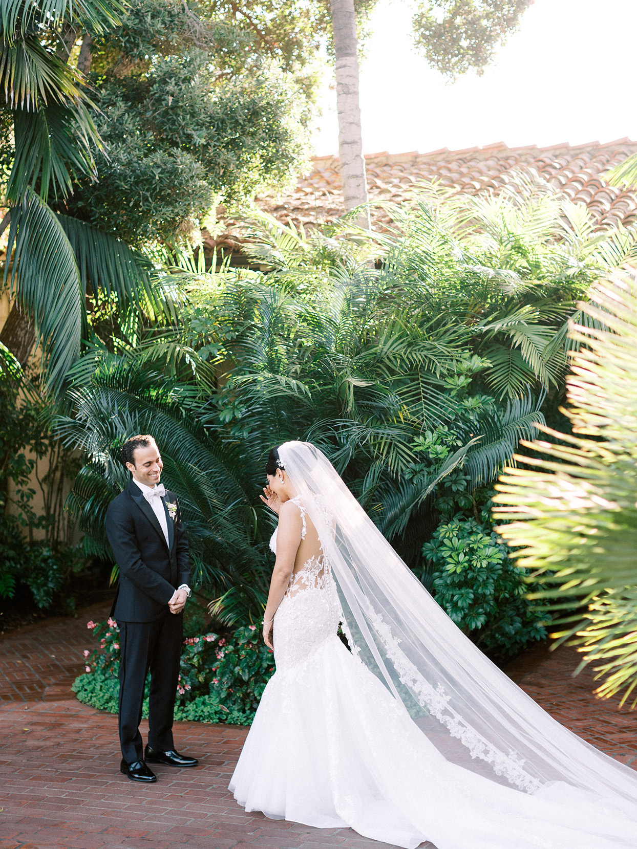 couple first look in resort courtyard