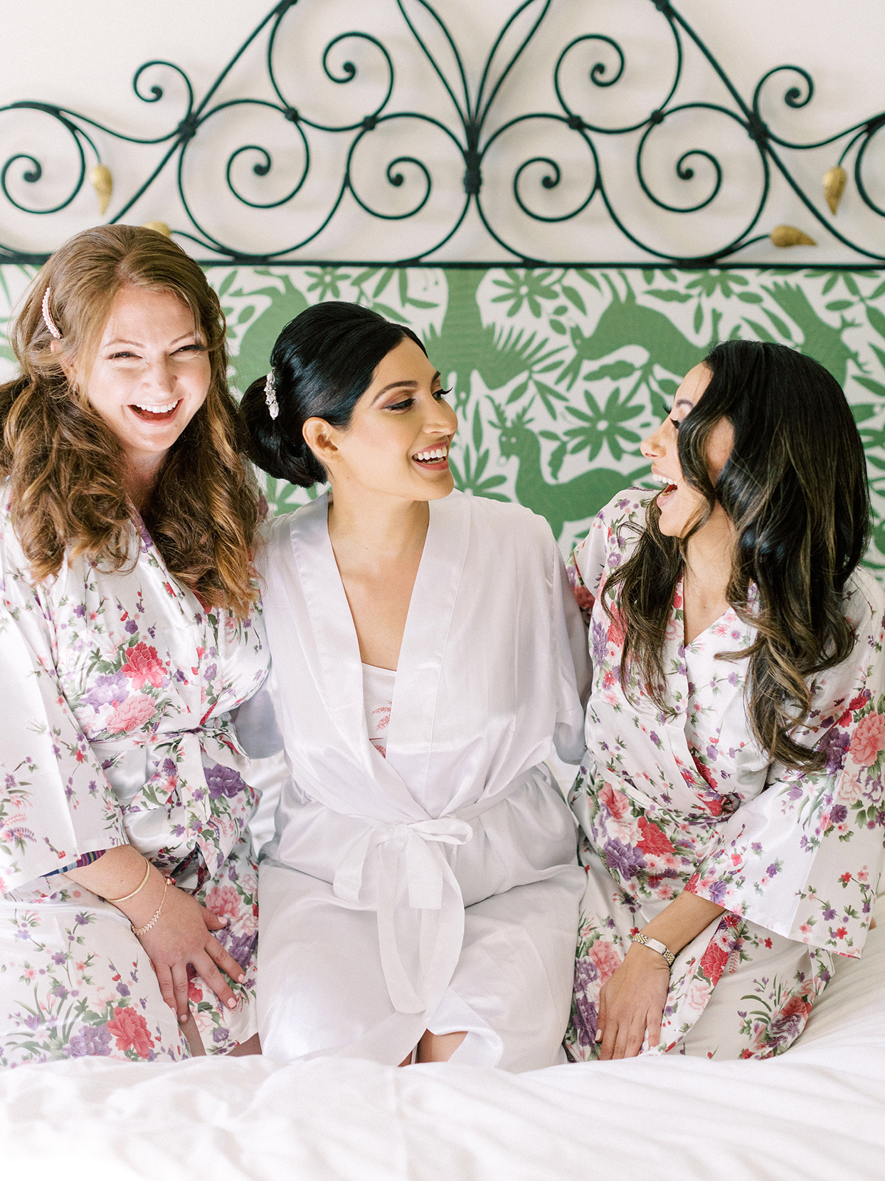 bride getting ready with bridesmaids in flowered bathrobes
