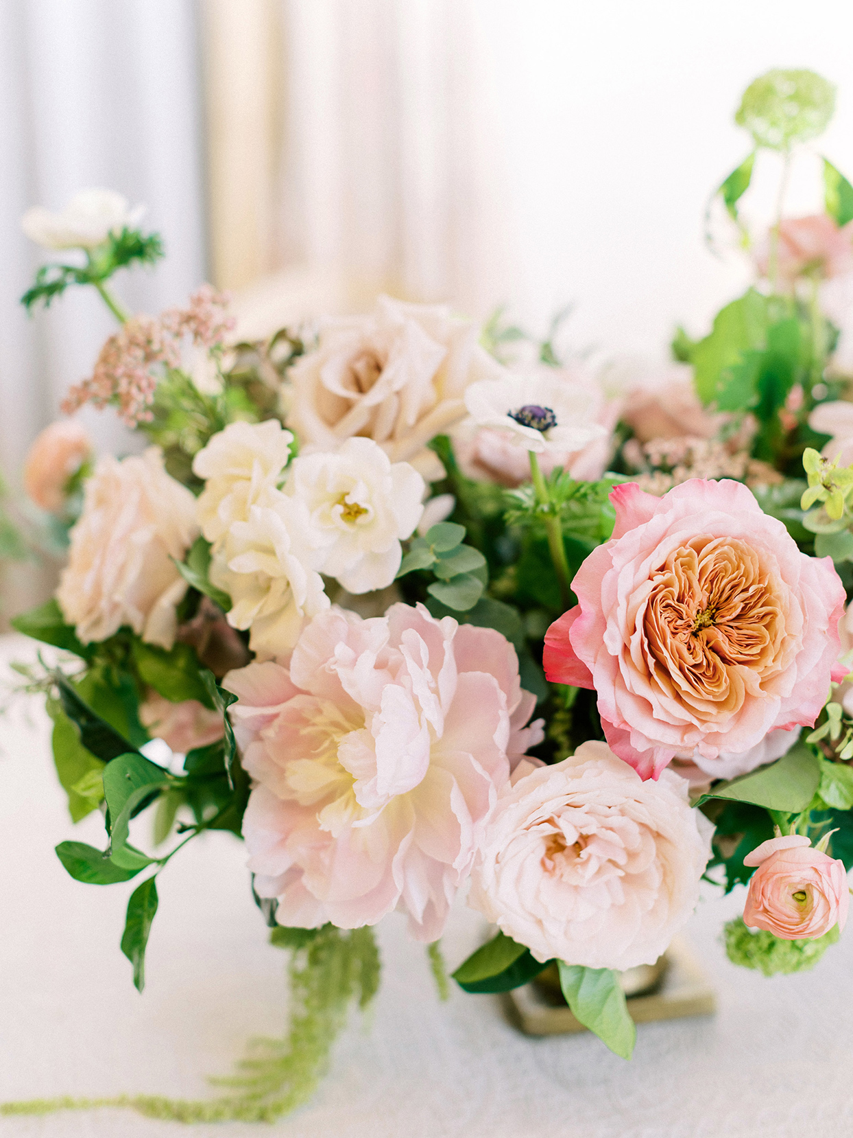 pastel pink flowers in wedding reception centerpiece
