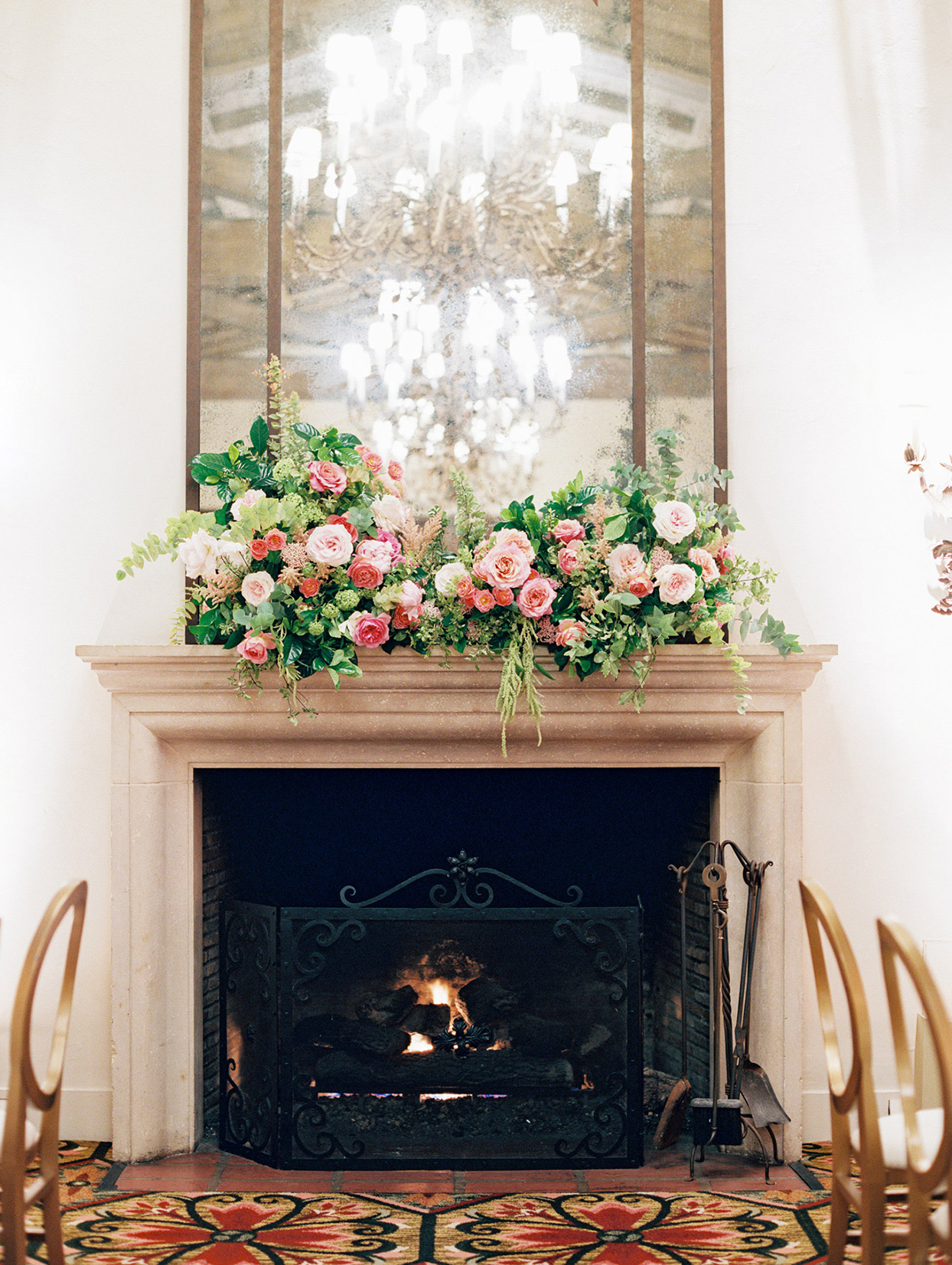wedding reception fireplace at venue with florals on mantel