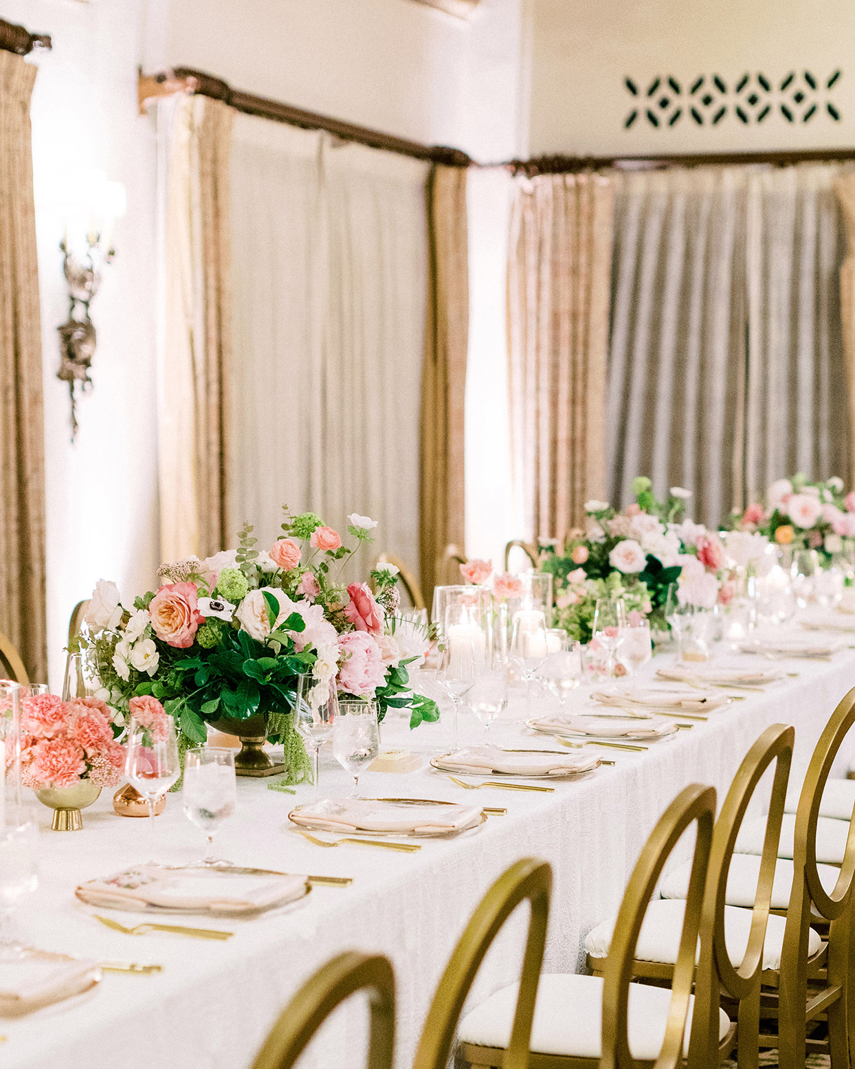 wedding long table with gold and pink accents