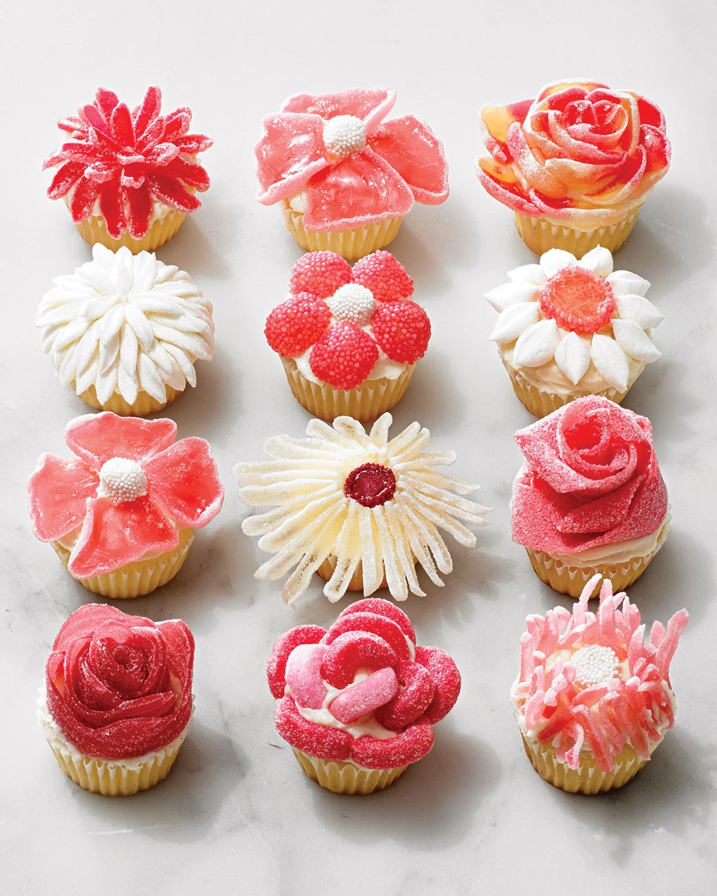 cupcakes decorated with flowers made from candy