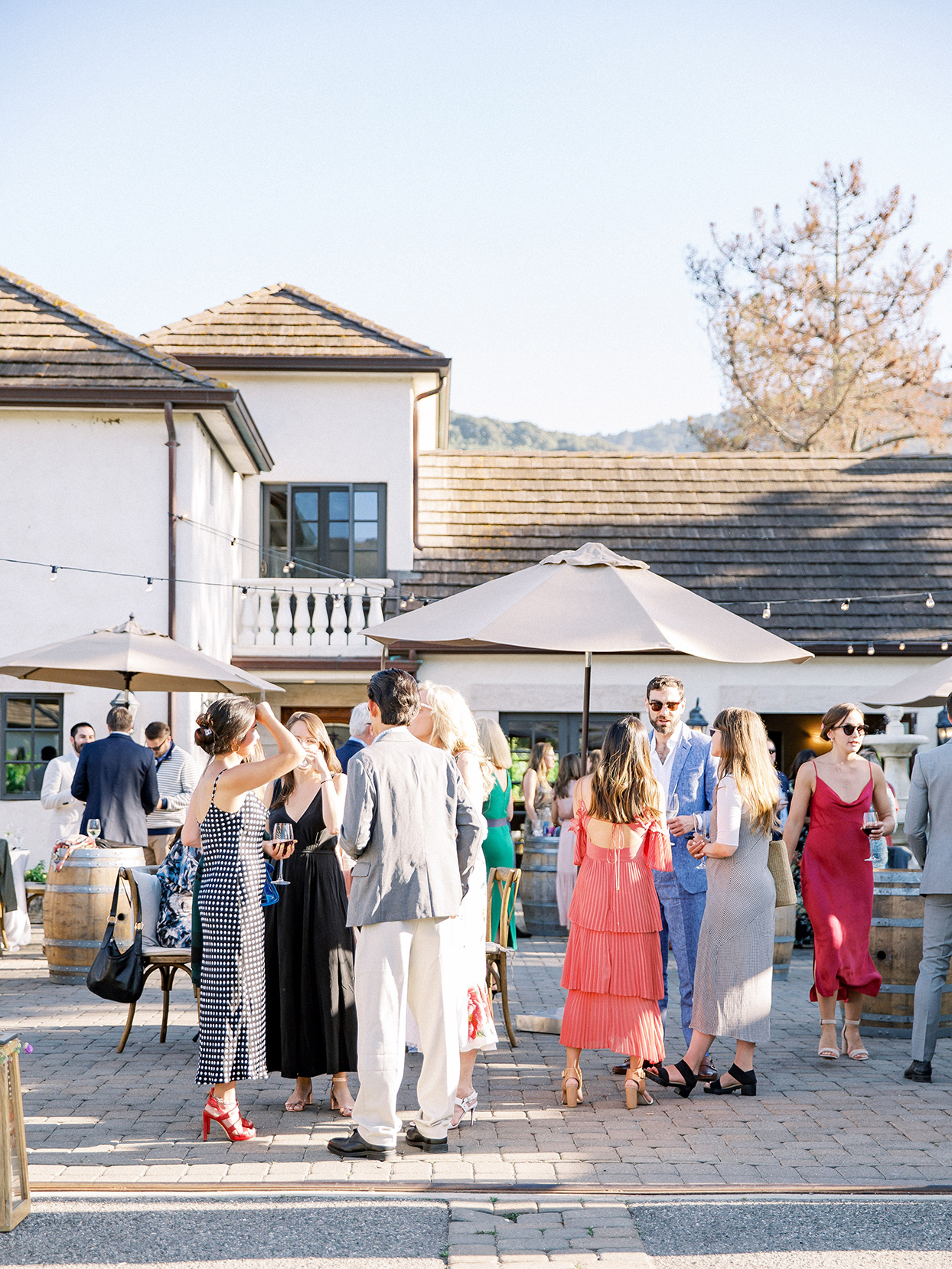 guests standing and enjoying drinks during cocktail hour