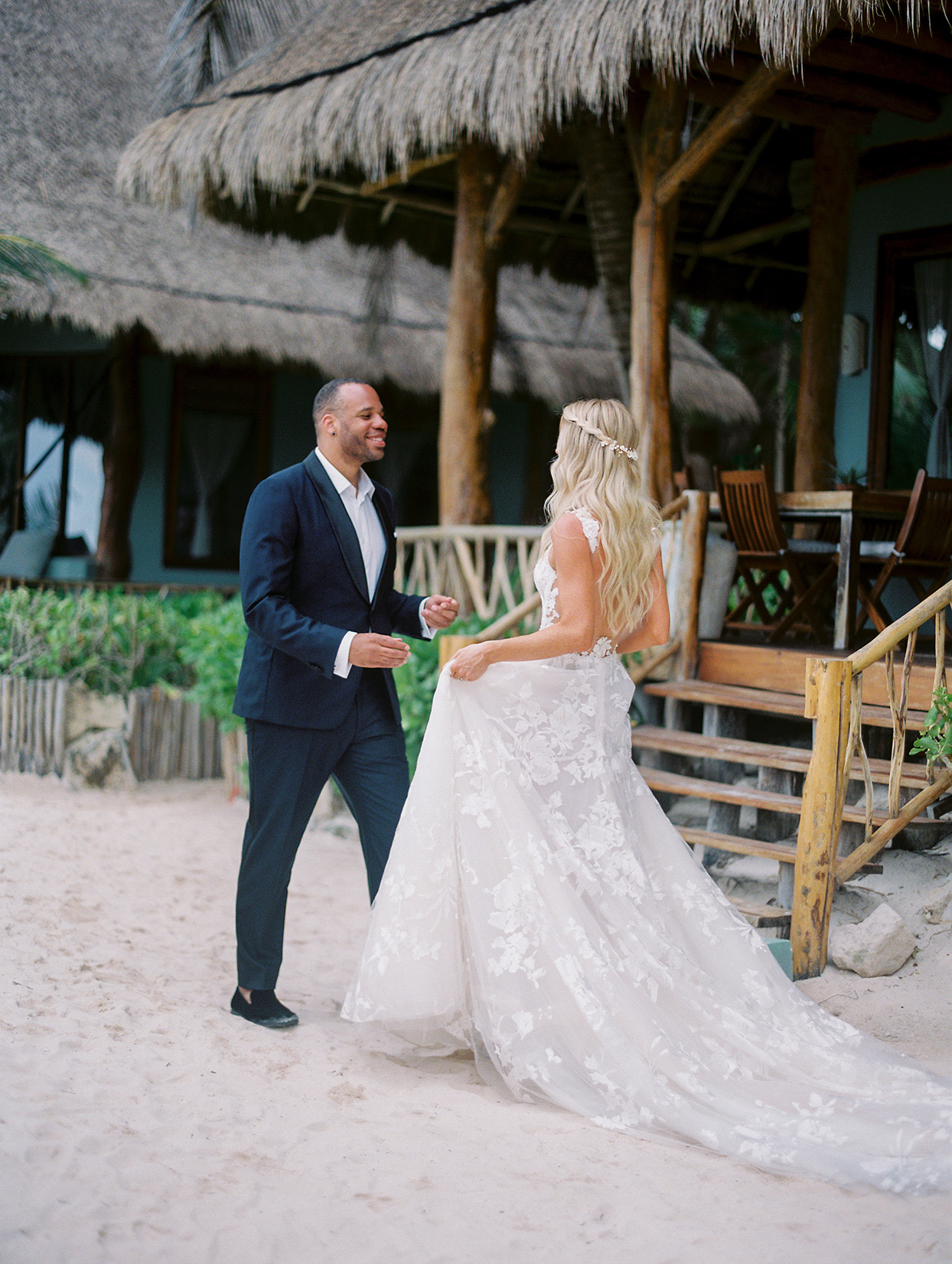 groom smiling at bride during first look on the beach