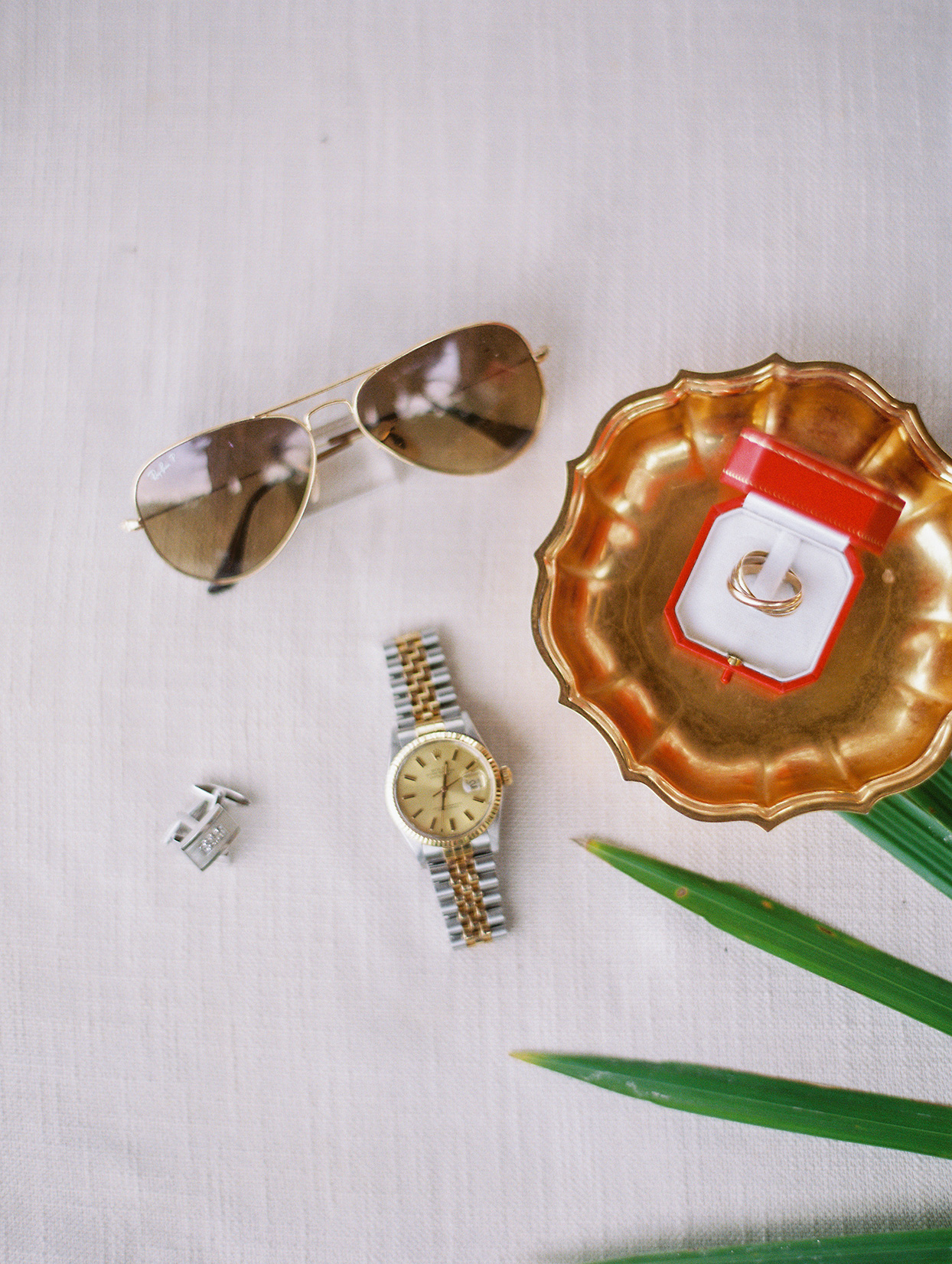 groom accessories watch, cufflinks, ring and sunglasses