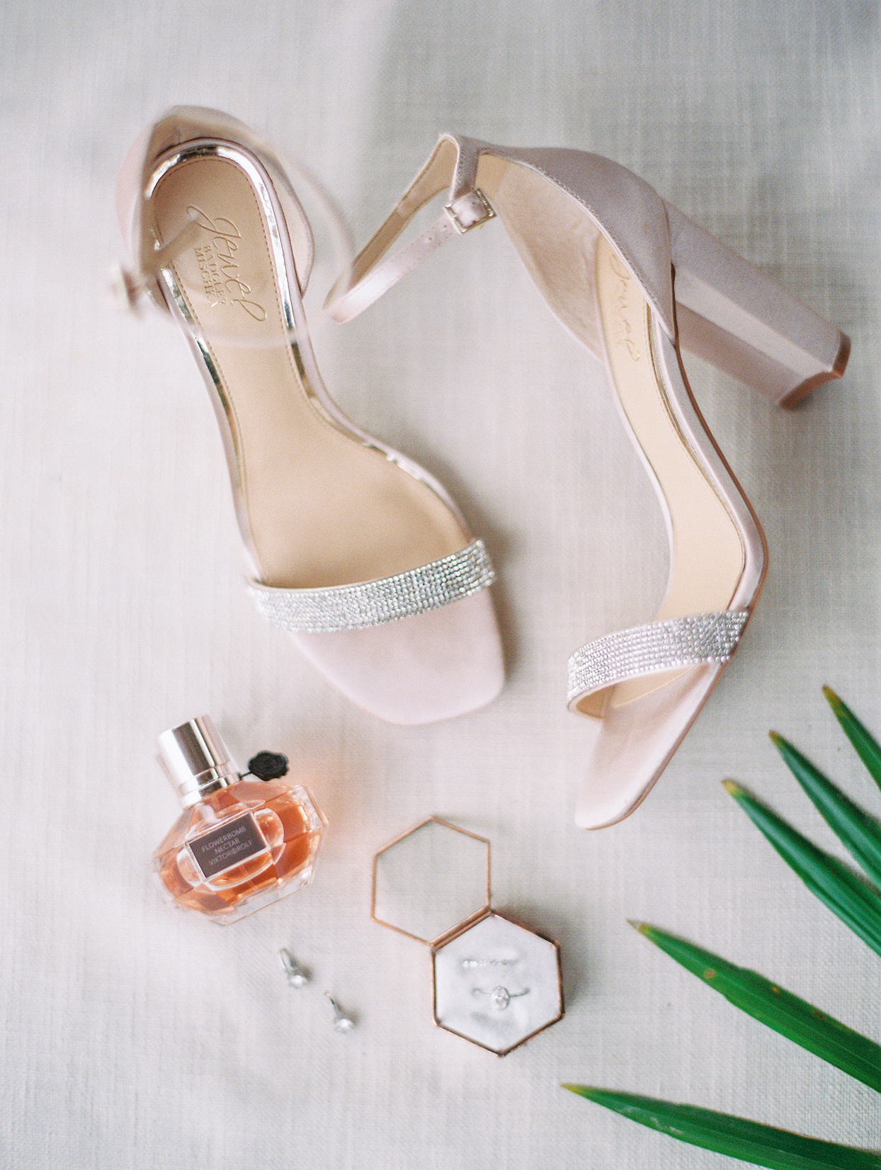 bride pastel pink wedding shoes, perfume, and jewelry