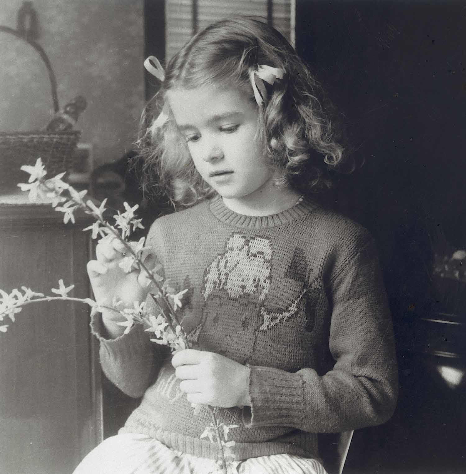 A young Martha arranging handpicked flowers for her mom