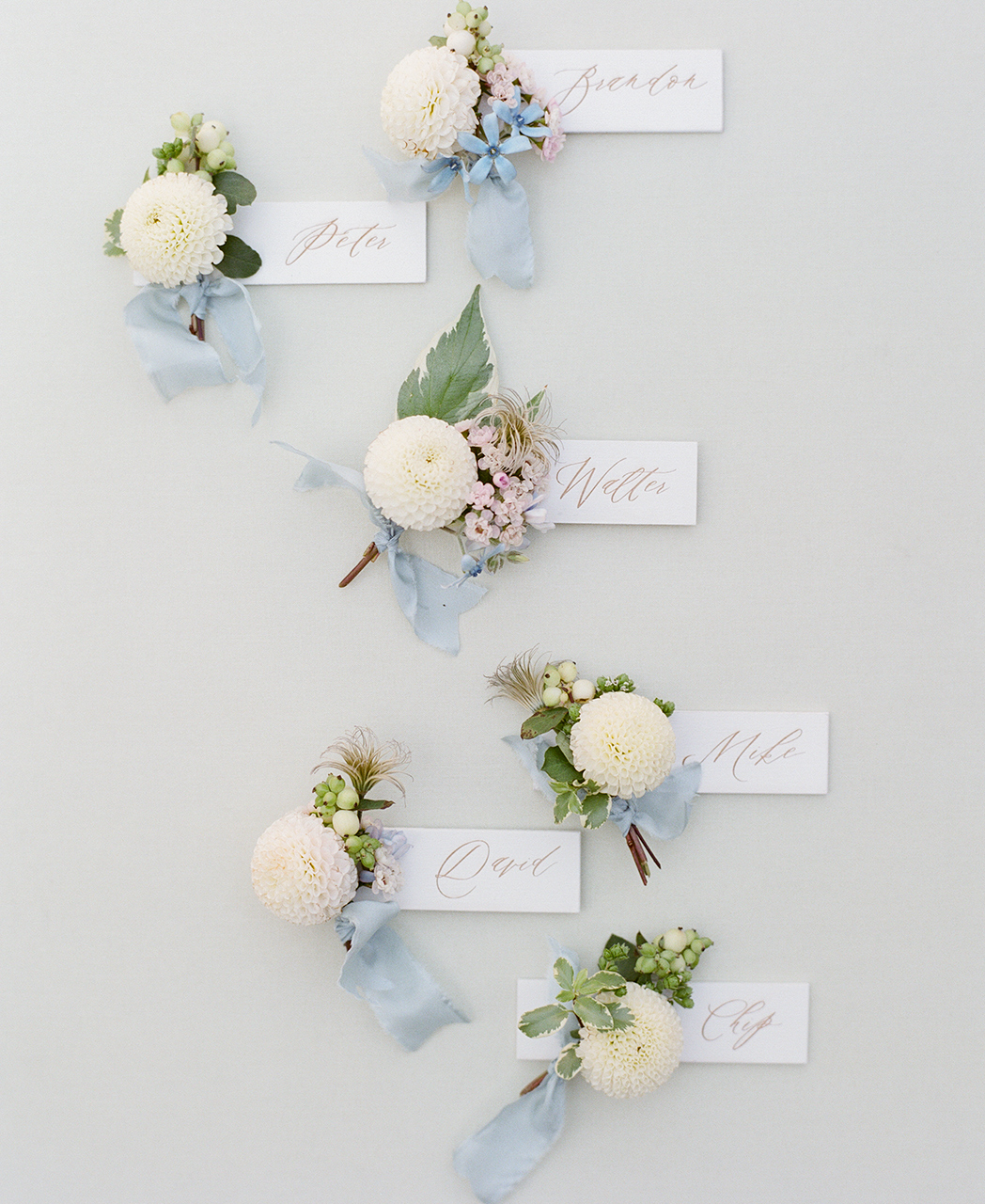 Petite Boutonniere tags dahlias with blue ribbon