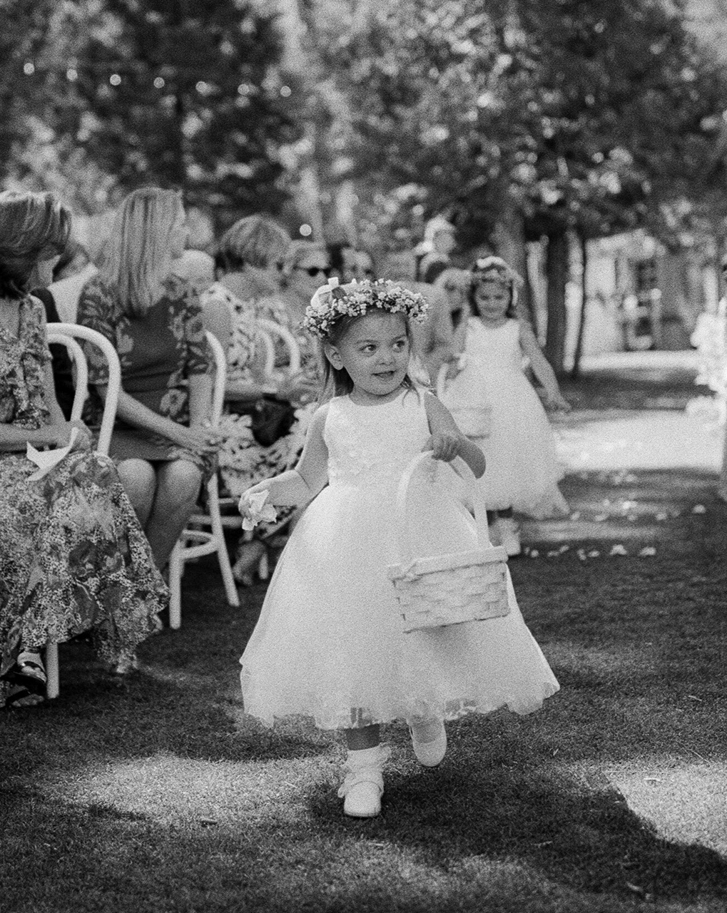 flower girls walking down aisle with baskets