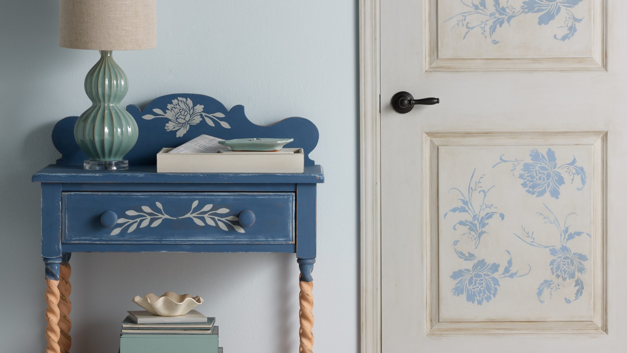 distressed painted side table and doorway