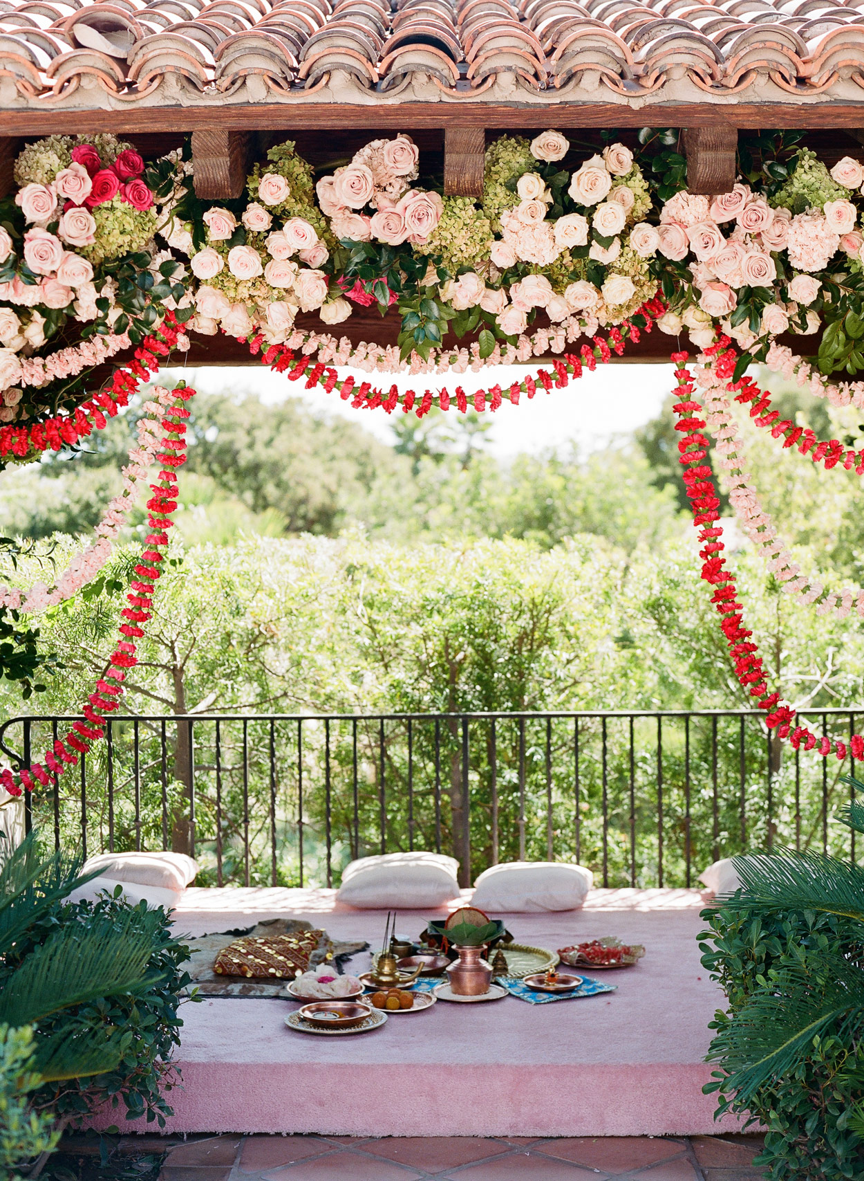 outdoor Indian ceremony space with floral arch